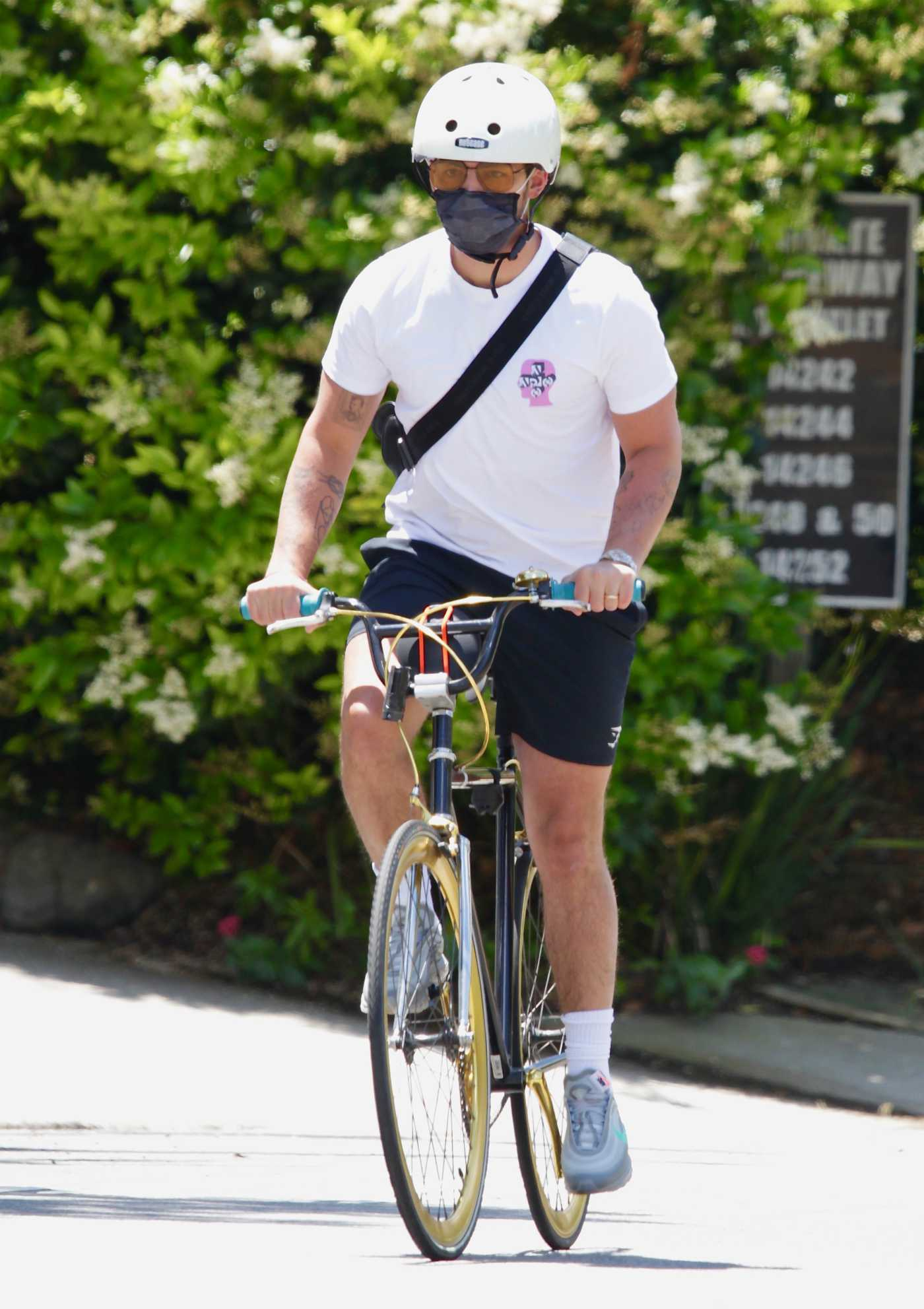 Joe Jonas in a White Tee Does a Bike Ride in Encino 05/19/2020