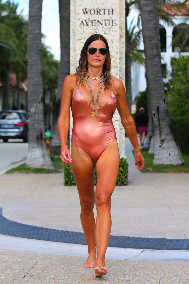 Kelly Bensimon in a Pink Swimsuit