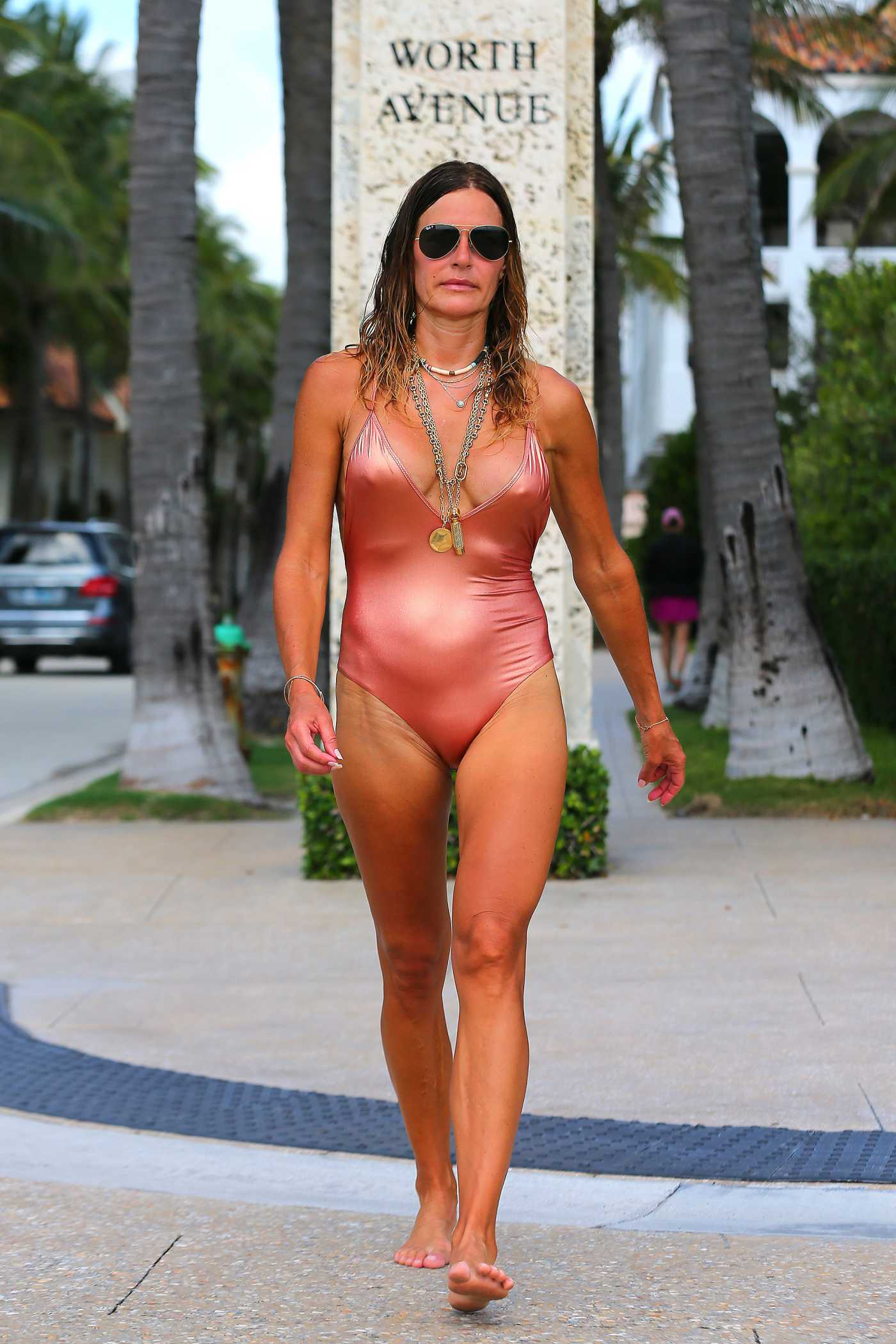 Kelly Bensimon in a Pink Swimsuit on the Beach in Pakm Beach 05/26/2020