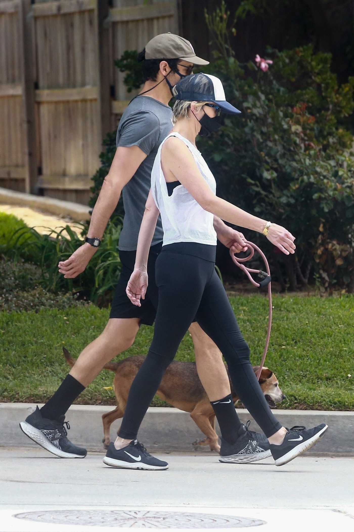 Kristen Wiig in a White Tank Top Goes for a Walk Out with  Avi Rothman in Los Angeles 05/11/2020