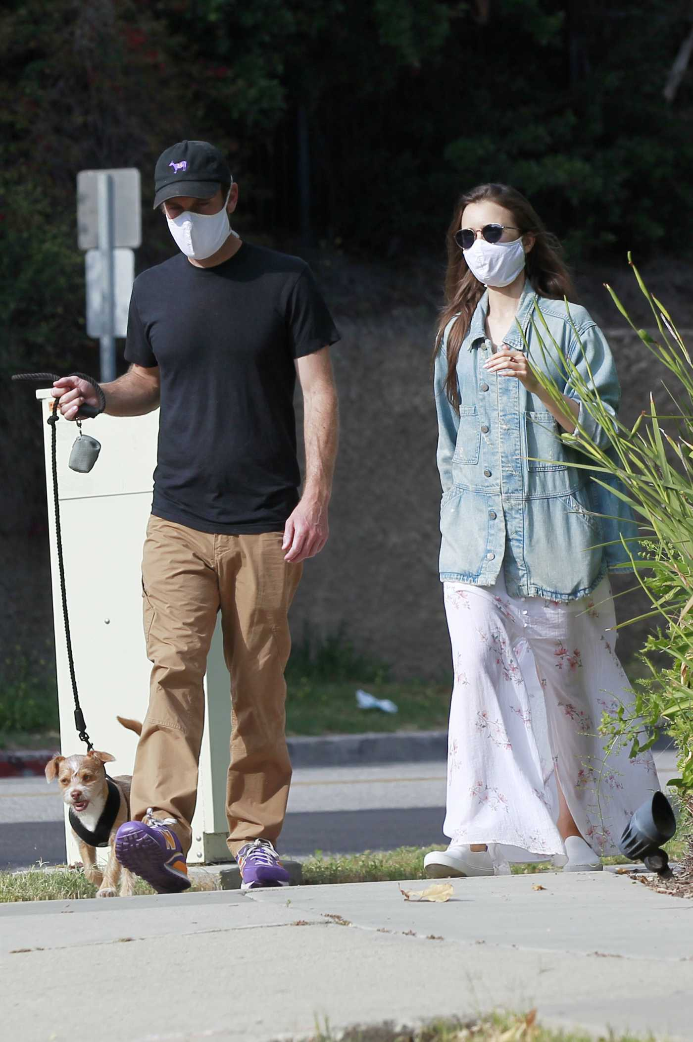 Lily Collins in a White Dress Walks Her Dog Out with Charlie McDowell in Beverly Hills 05/11/2020