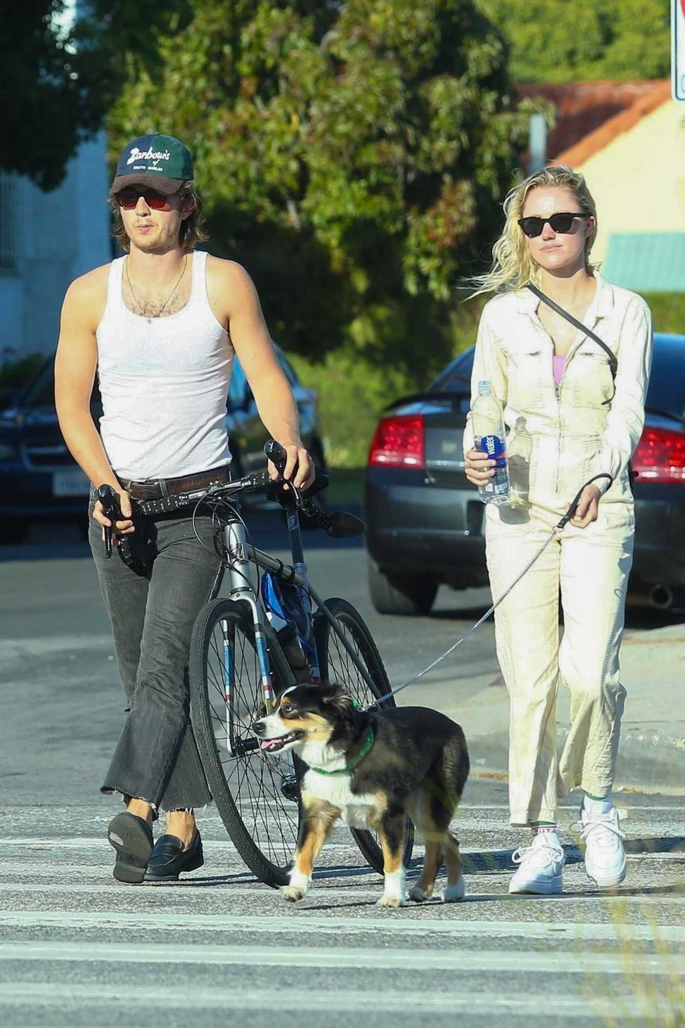 Maika Monroe in a White Sneakers Walks Her Dog Out with Joe Keery in West Hollywood 05/22/2020