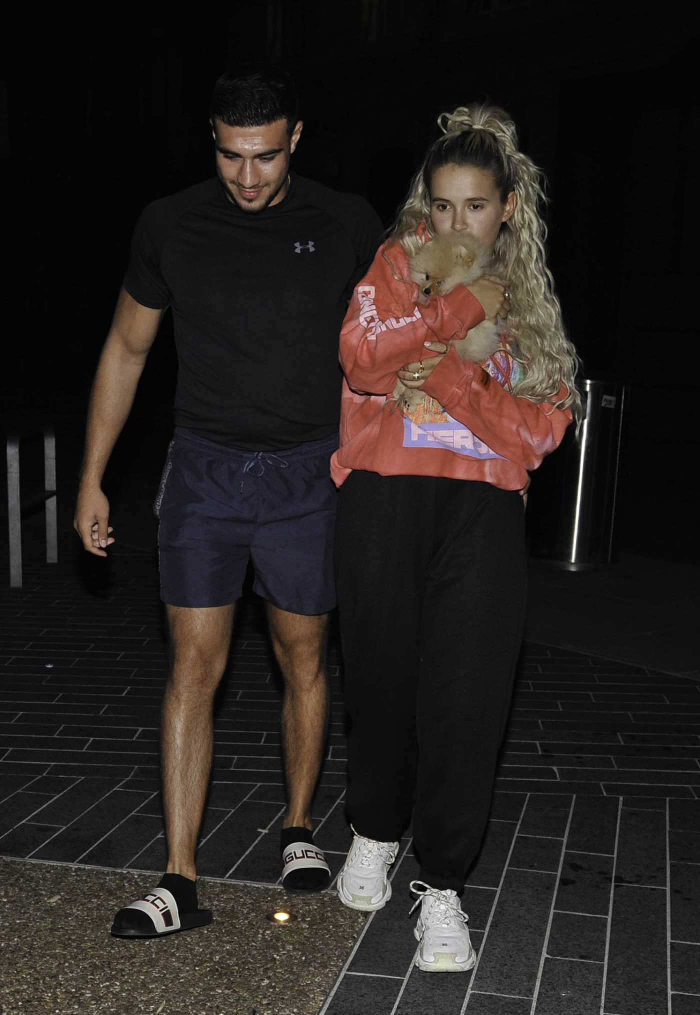 Molly-Mae Hague in a Black Sweatpants Was Seen Out with Tommy Fury and Baby Pomeranian Mr Chai in Manchester 05/28/2020