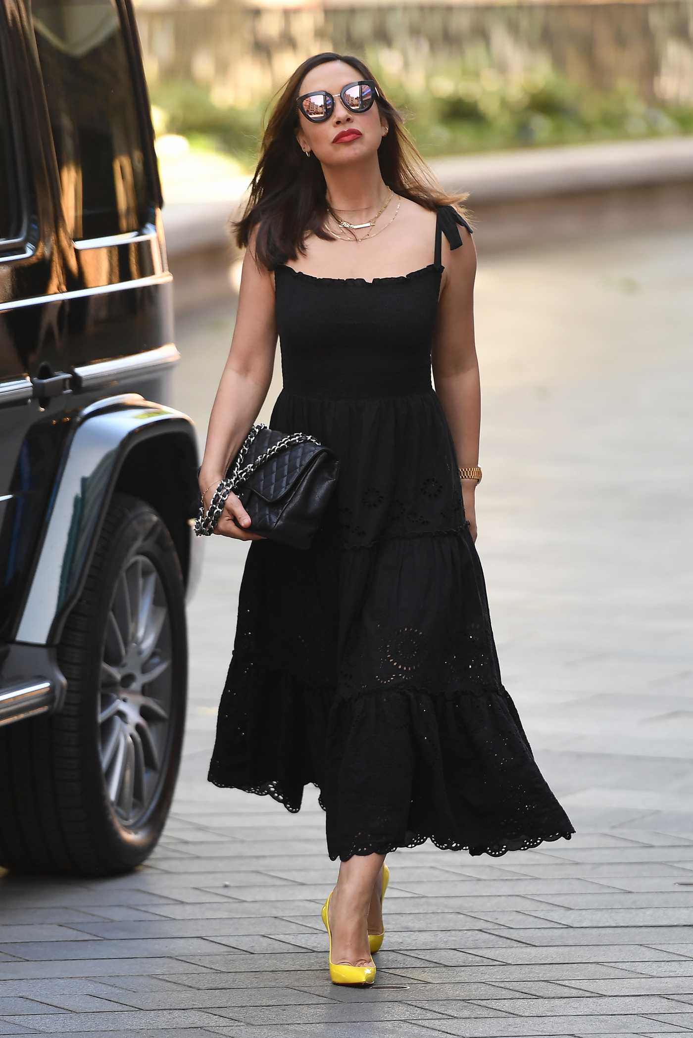 Myleene Klass in a Black Dress Arrives at the Global Radio Studios in London 05/28/2020