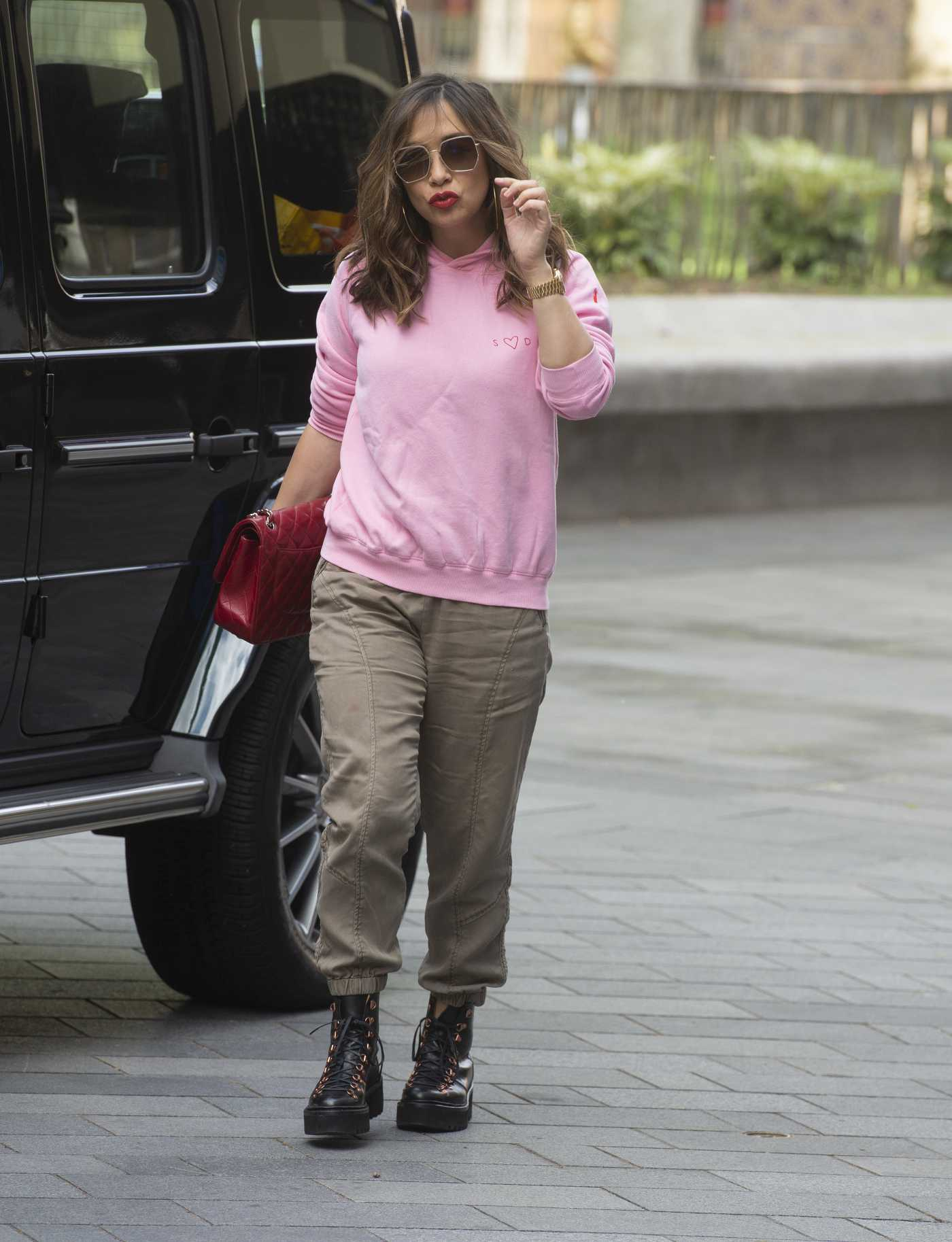 Myleene Klass in a Pink Hoody Arrives at the Global Studios in London 05/13/2020