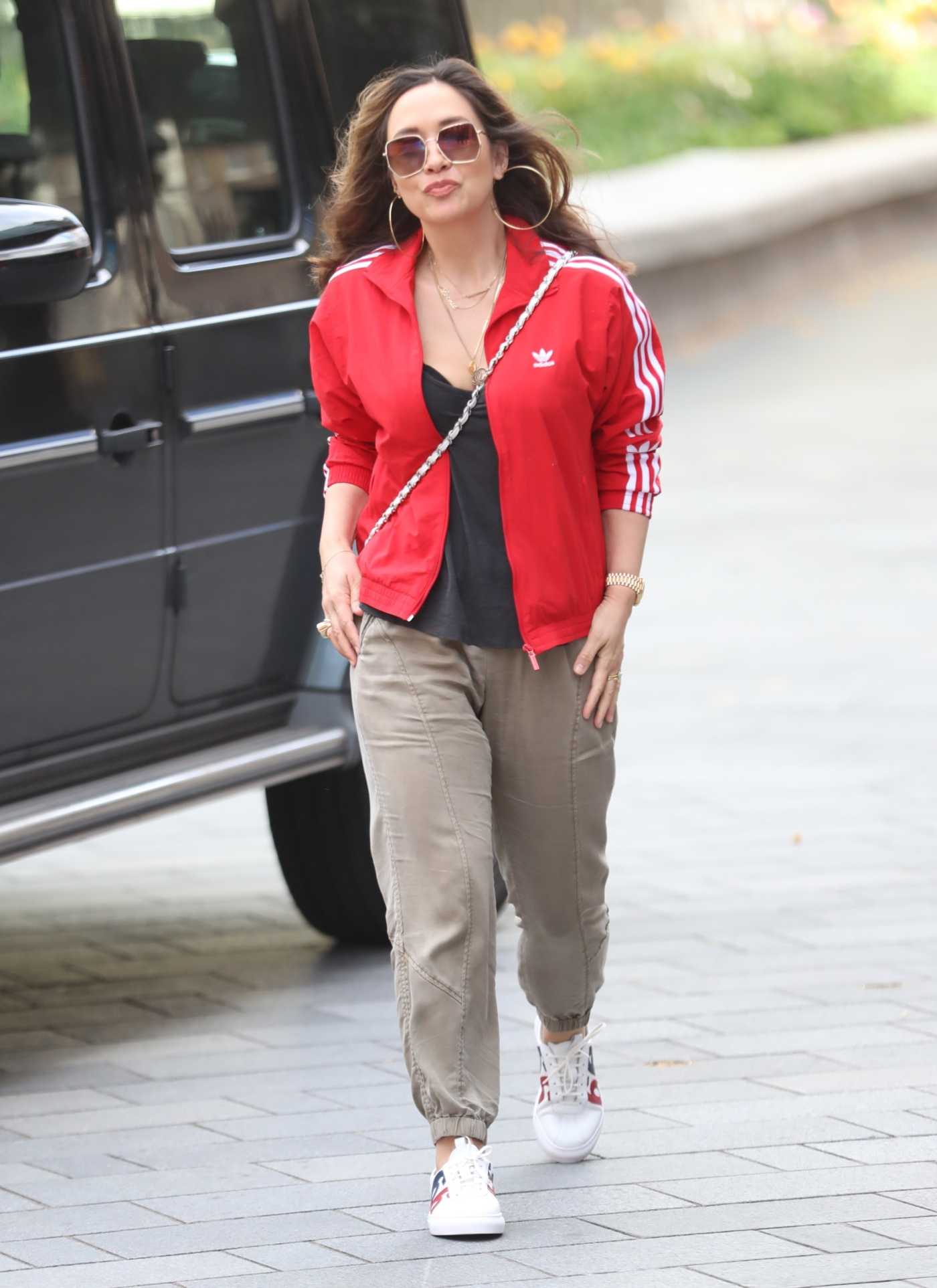 Myleene Klass in a Red Adidas Track Jacket Arrives at the Global Studios in London 05/05/2020