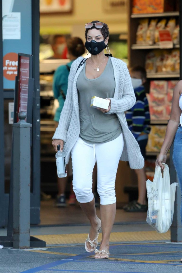 Nicole Murphy in a Black Protective Mask