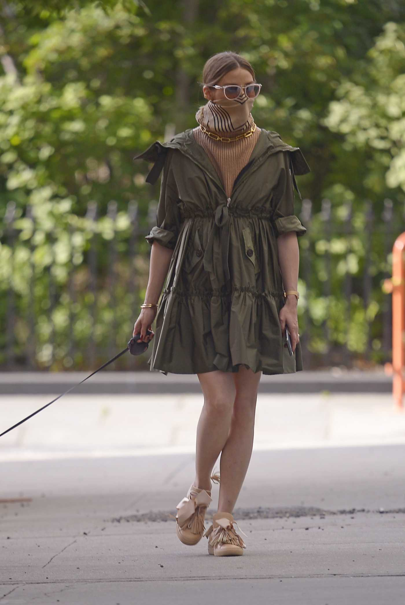 Olivia Palermo in a Beige Bandana as a Face Mask Walks Her Dog in New York 05/19/2020