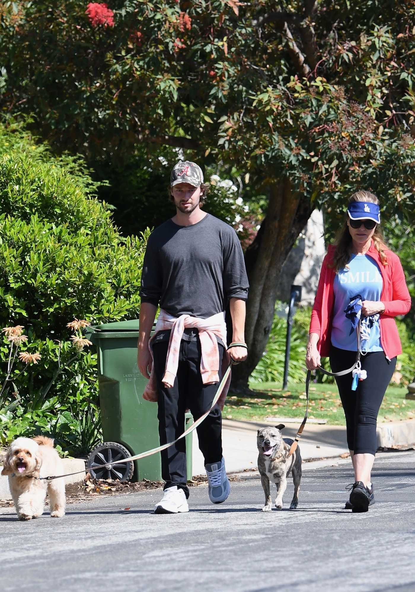 Patrick Schwarzenegger in a Camo Cap Walks His Dog Out with Maria Shriver in Brentwood 05/10/2020