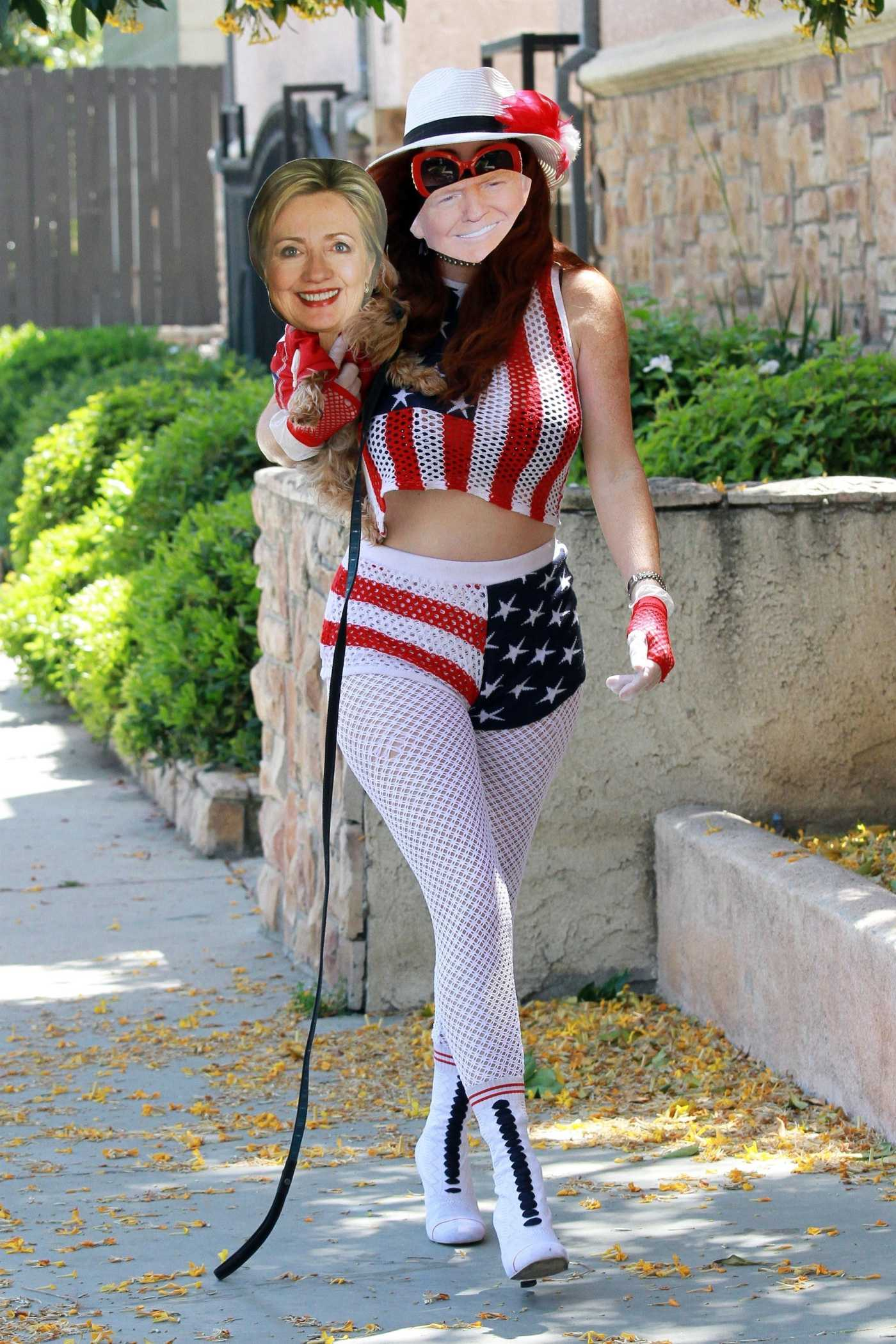 Phoebe Price in a Patriotic Outfit Has a Some Fun with a Donald Trump and Hillary Clinton Masks  in Studio City 05/02/2020