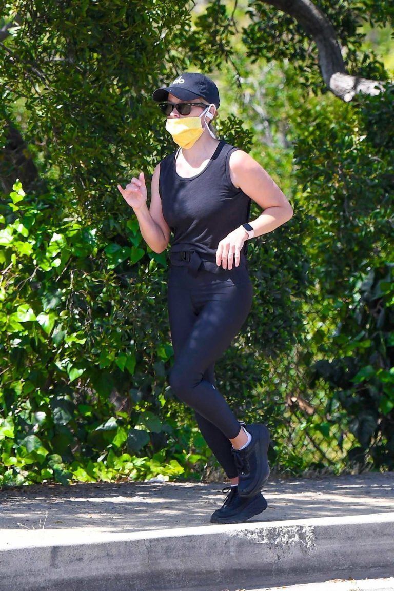 Reese Witherspoon in a Yellow Protective Mask
