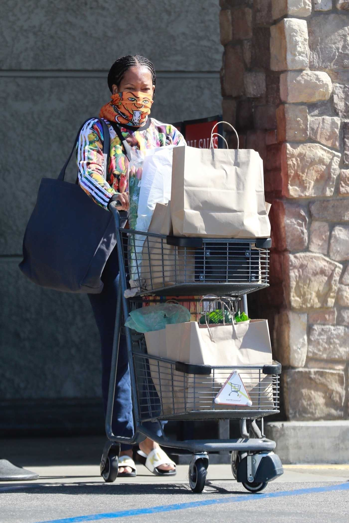 Regina King in an Orange Bandana as a Face Mask Goes Shopping at Gelson's in Los Feliz 05/16/2020