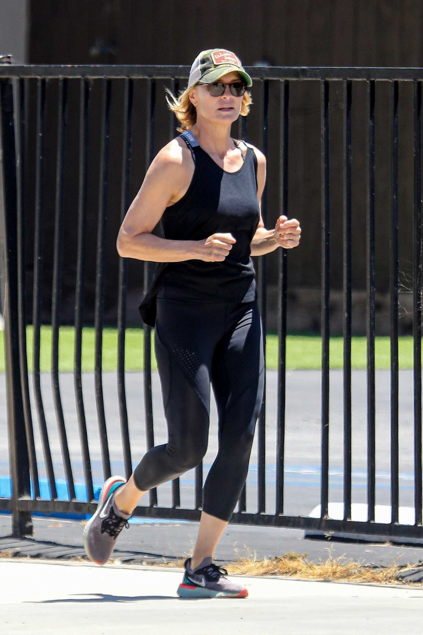 Robin Wright in a Black Tank Top Does a Morning Jog in Santa Monica  05/20/2020