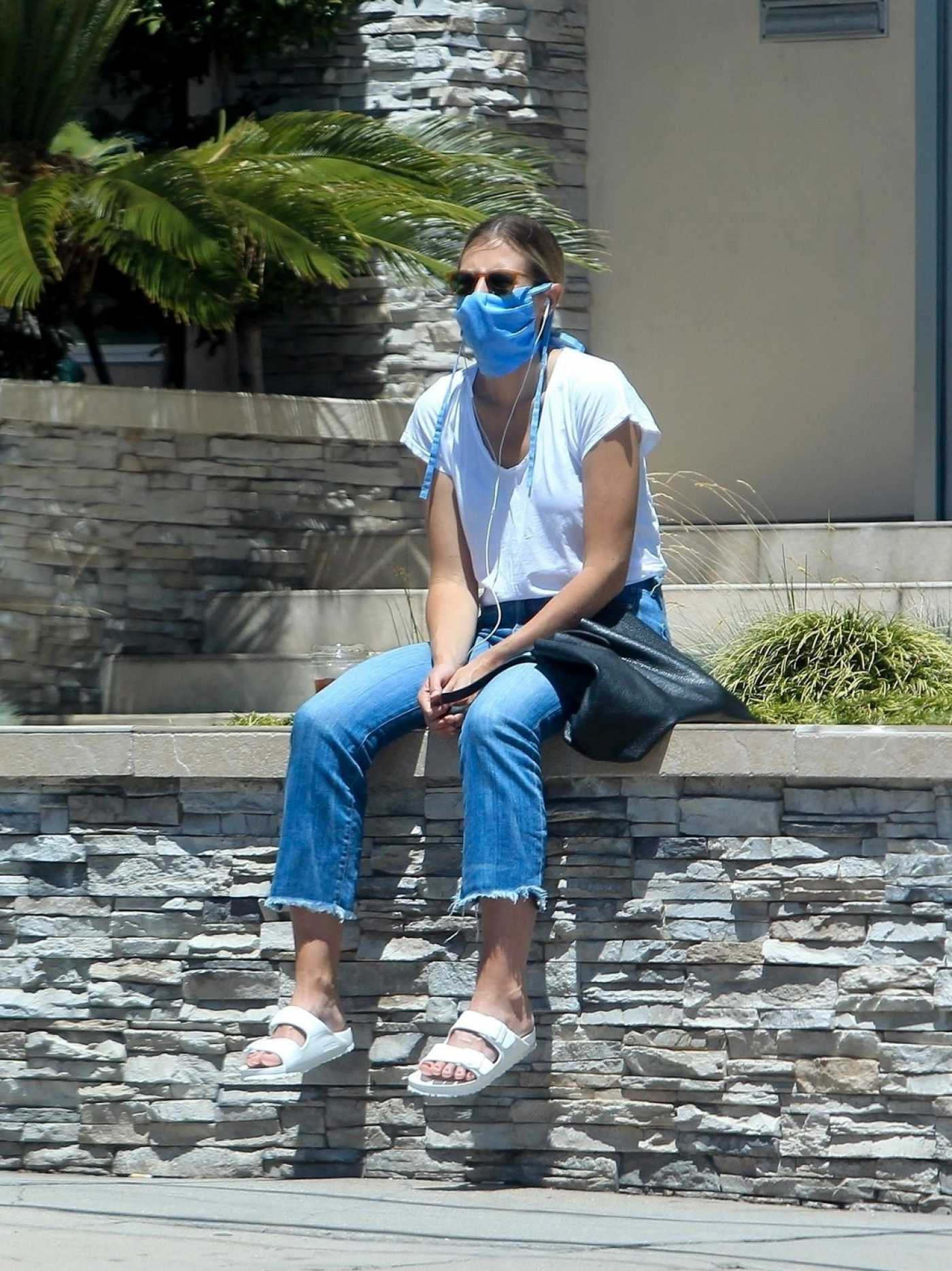 Sara Foster in a Blue Protective Mask Waits on a Friend in West Hollywood 05/25/2020
