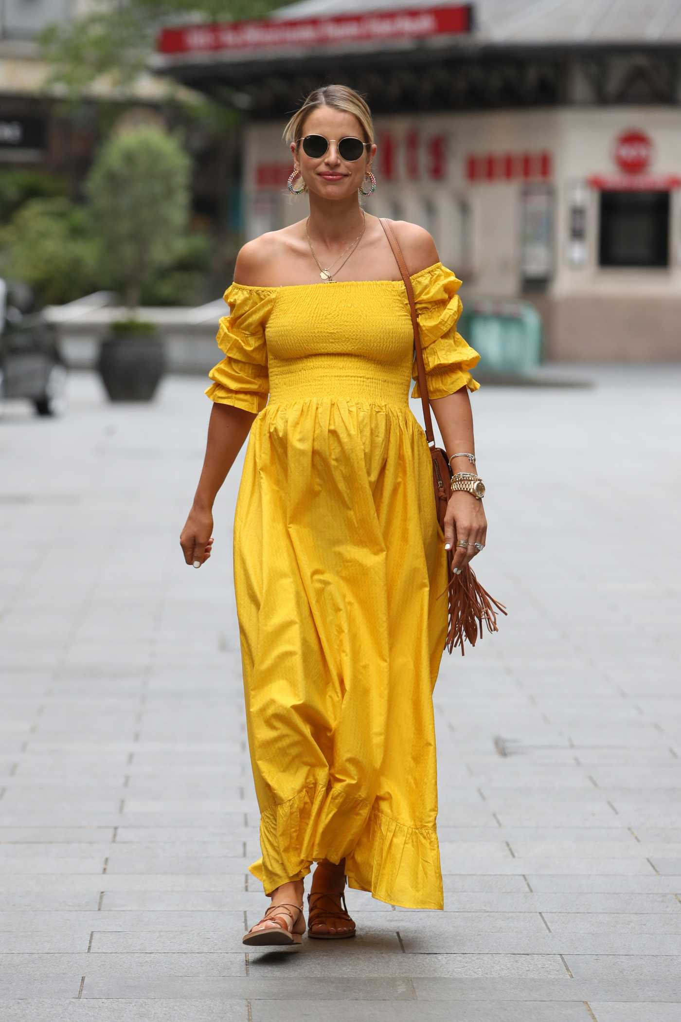 Vogue Williams in a Yellow Dress Arrives at the Global Radio in London 05/24/2020
