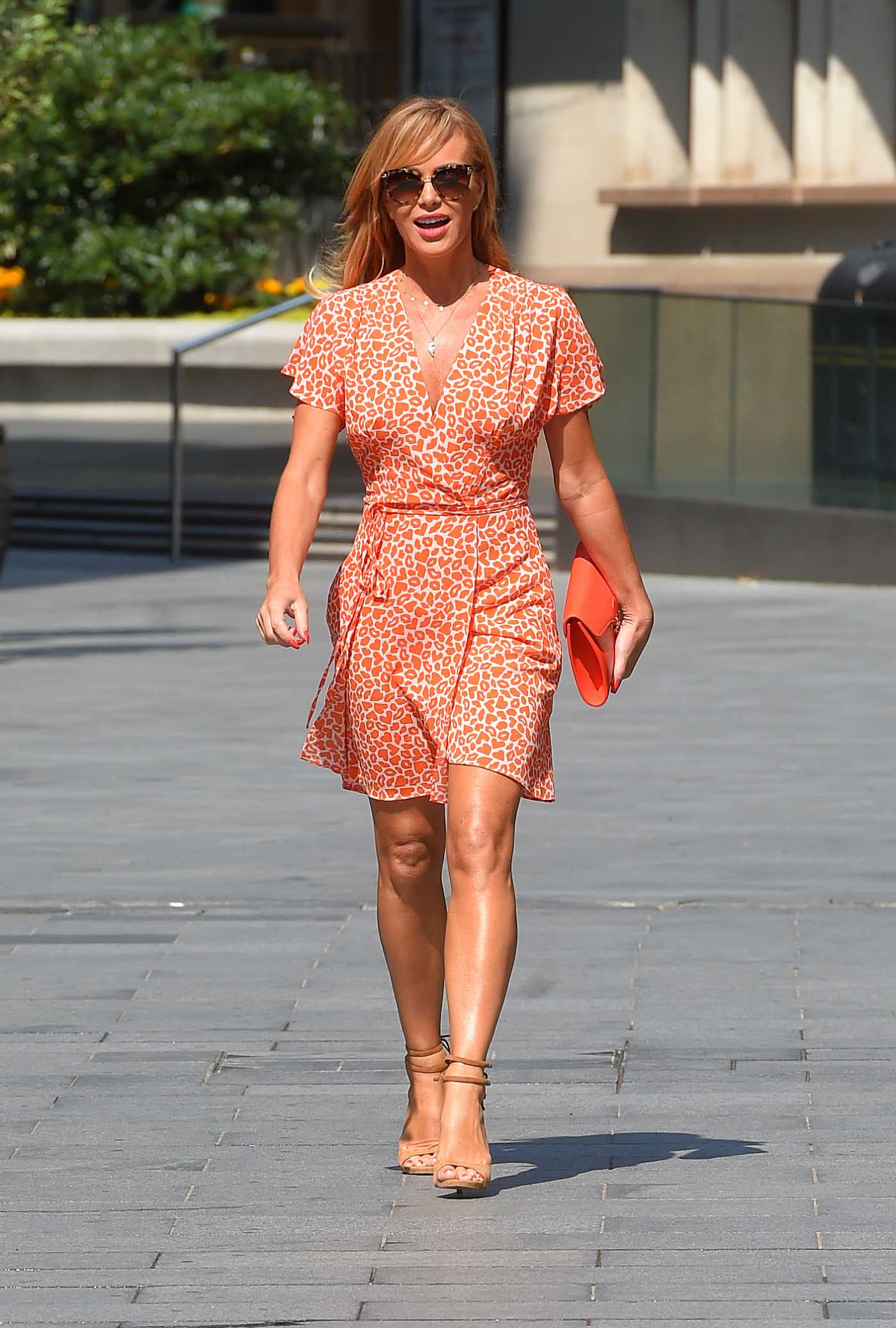 Amanda Holden in an Orange Animal Print Mini Dress Exits the Heart Radio in  in London 06/24/2020