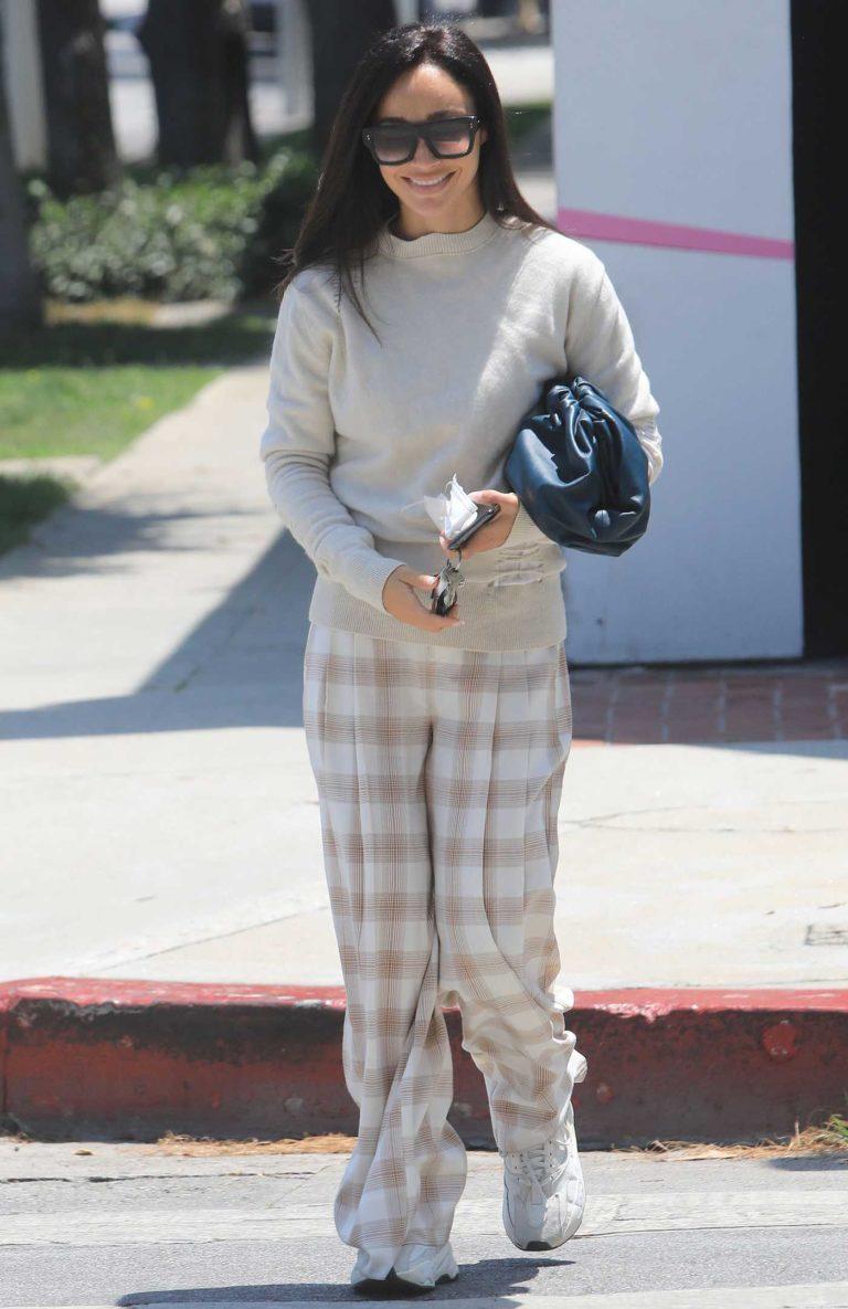 Cara Santana in a Beige Sweater