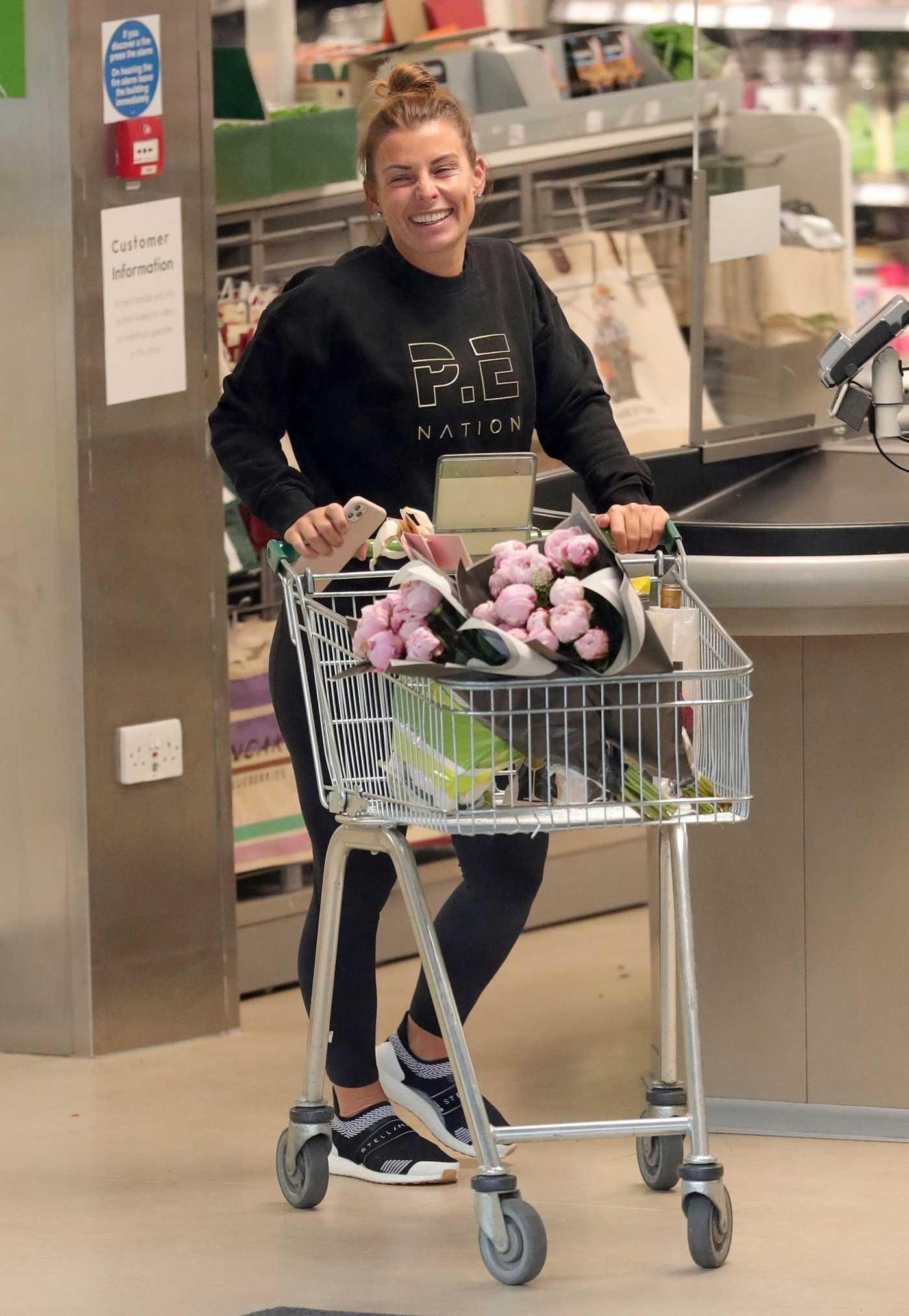 Coleen Rooney in a Black Sweatshirt Shops for Flowers at Waitrose Supermarket in Alderley Edge, Cheshire 06/04/2020