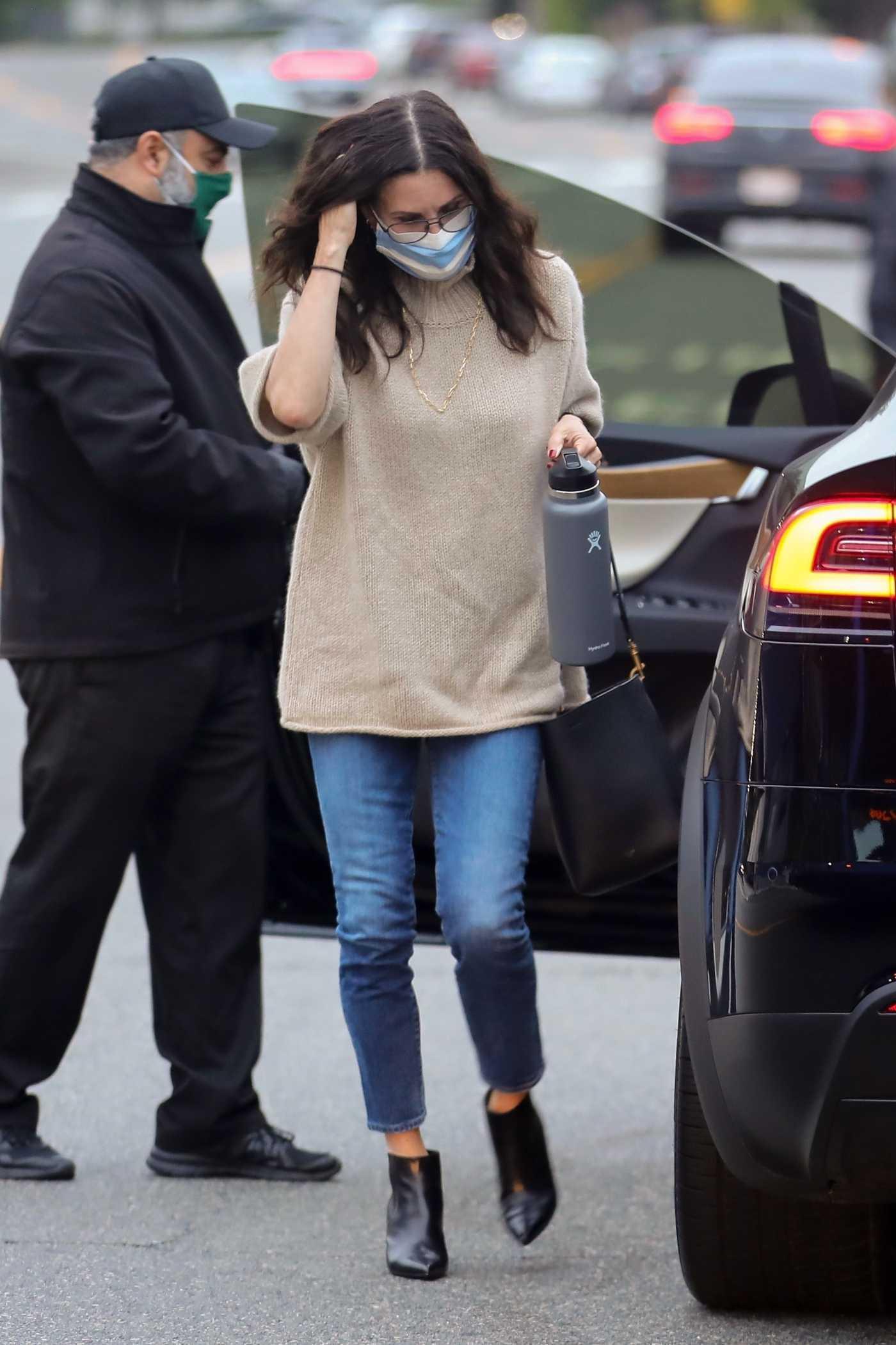 Courteney Cox in a Knit Cream Sweater Arrives at Giorgio Baldi Restaurant in Santa Monica 06/24/2020