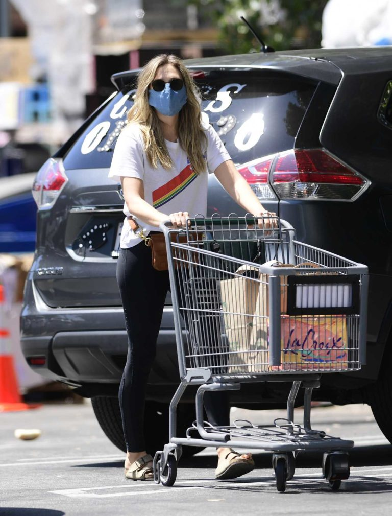 Elizabeth Olsen in a Protective Mask