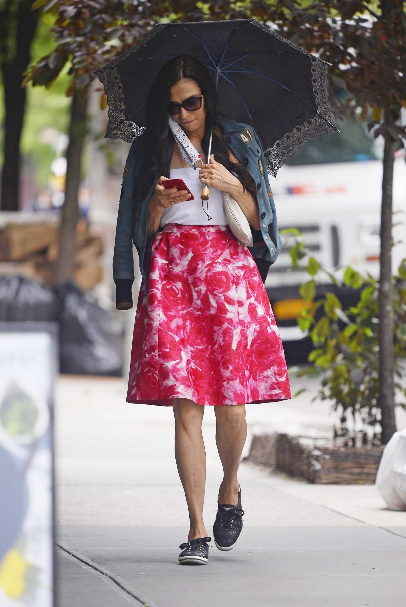 Famke Janssen in a Bright Summer Skirt Was Seen Out in New York 06/02/2020