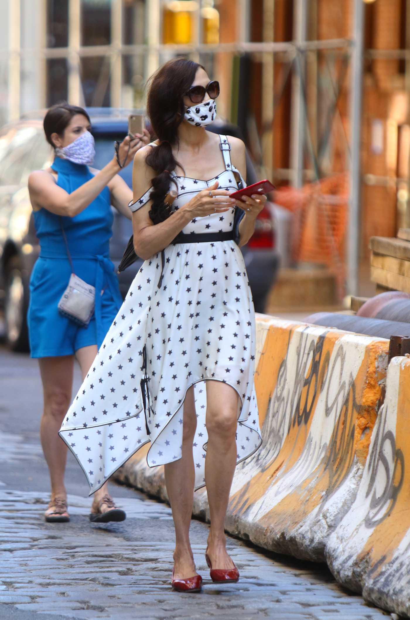 Famke Janssen in a Star Print White Dress Was Seen Out in Soho, Manhattan 06/13/2020