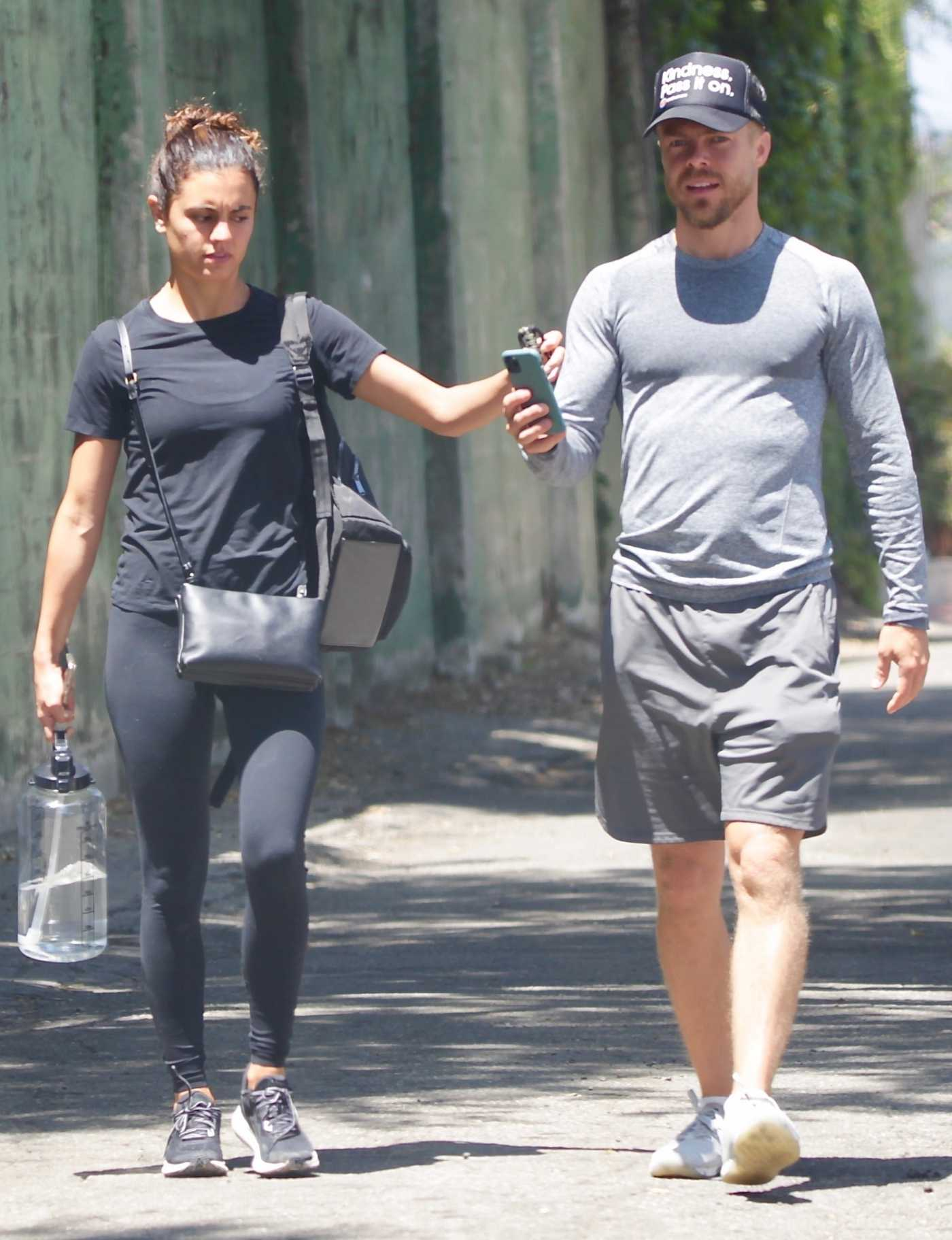 Hayley Erbert in a Black Tee Was Spotted Out with Derek Hough Hiking Around the Silver Lake Reservoir in Los Angeles 06/22/2020