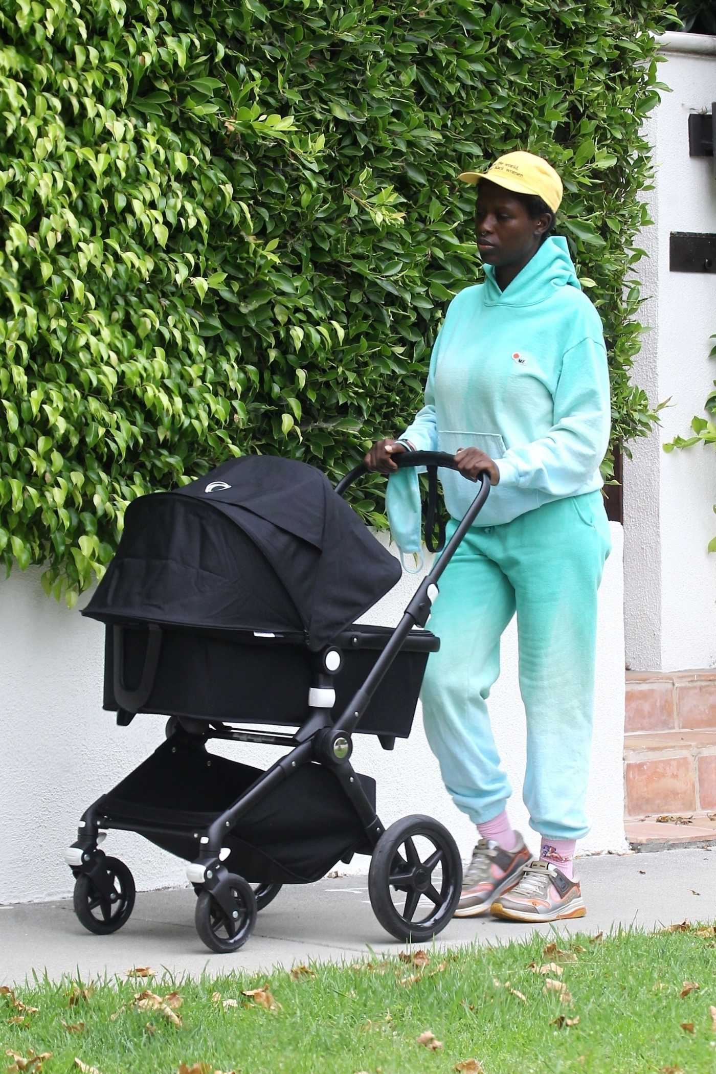 Jodie Turner-Smith in a Yellow Cap Takes an Afternoon Stroll with Her Newborn Baby in Los Angeles 06/16/2020