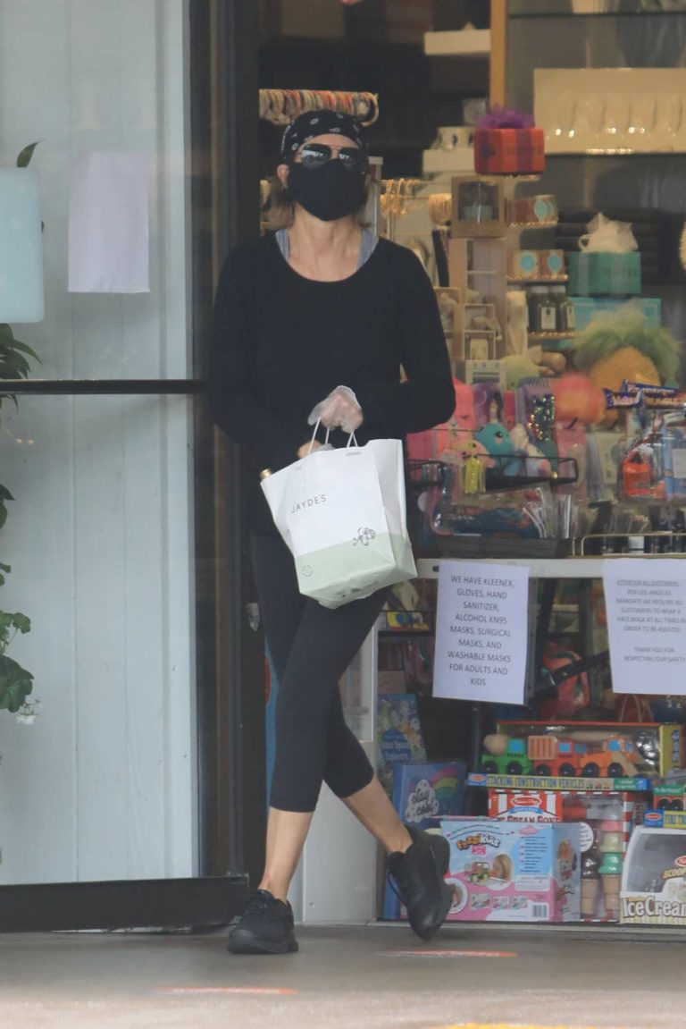 Lisa Rinna in a Black Protective Mask