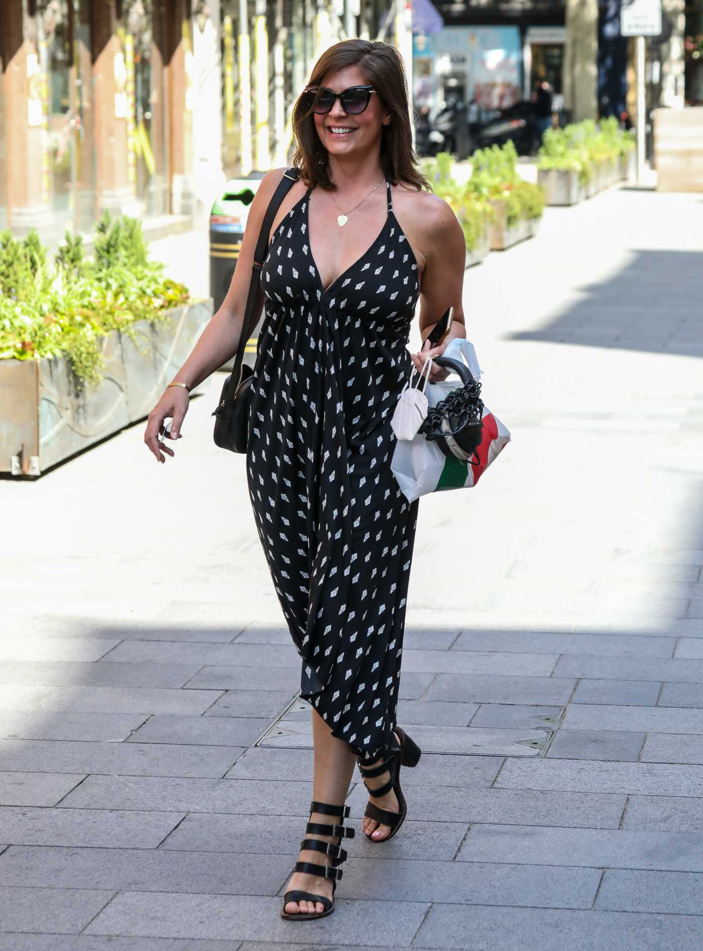 Lucy Horobin in a Black Summer Dress Arrives at the Global Radio Studios in London 06/16/2020