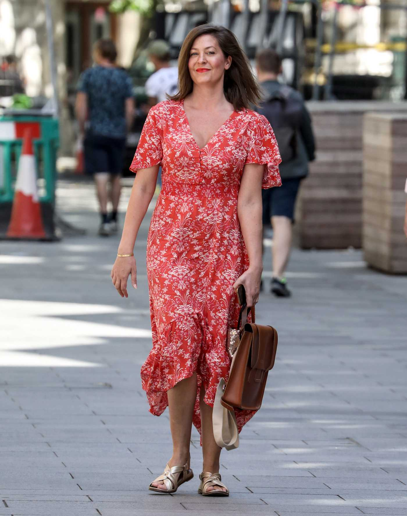 Lucy Horobin in a Red Floral Dress Arrives at the Global Radio Studios in London 06/22/2020