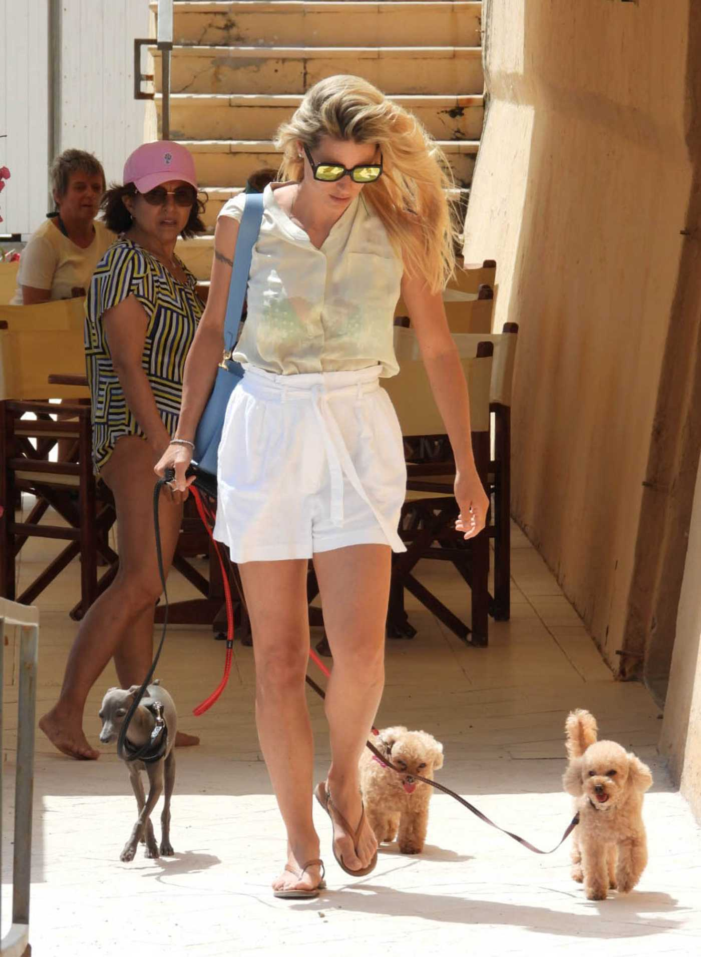 Michelle Hunziker in a White Shorts Enjoys a Day on the Beach in Varigotti 06/19/2020