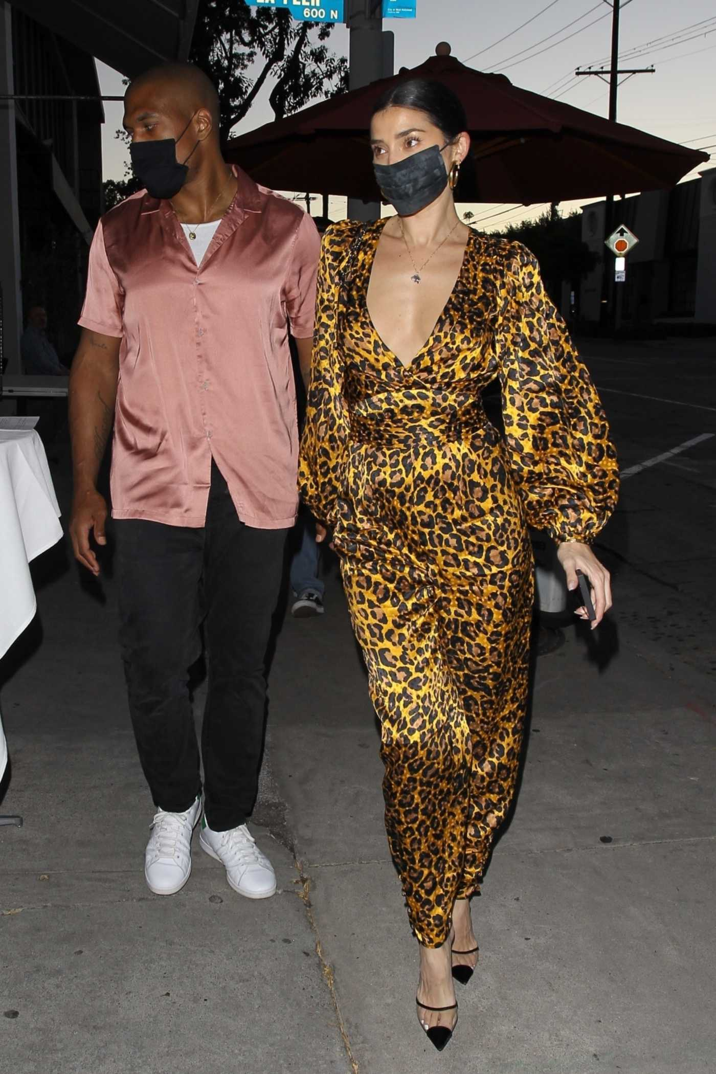 Nicole Williams in an Animal Print Coverall Arrives for Dinner at Craig's Restaurant Out with Larry English in West Hollywood 06/08/2020