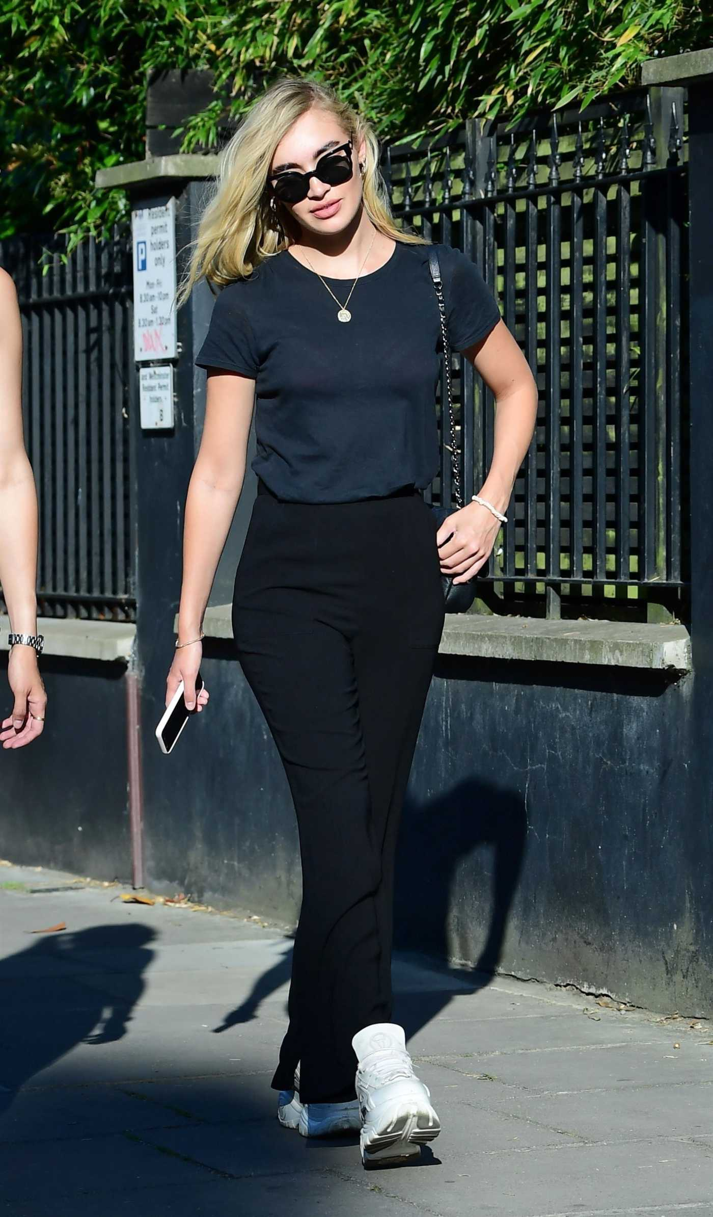 Roxy Horner in a Black Tee Was Seen Out with a Friend in London 06/02/2020