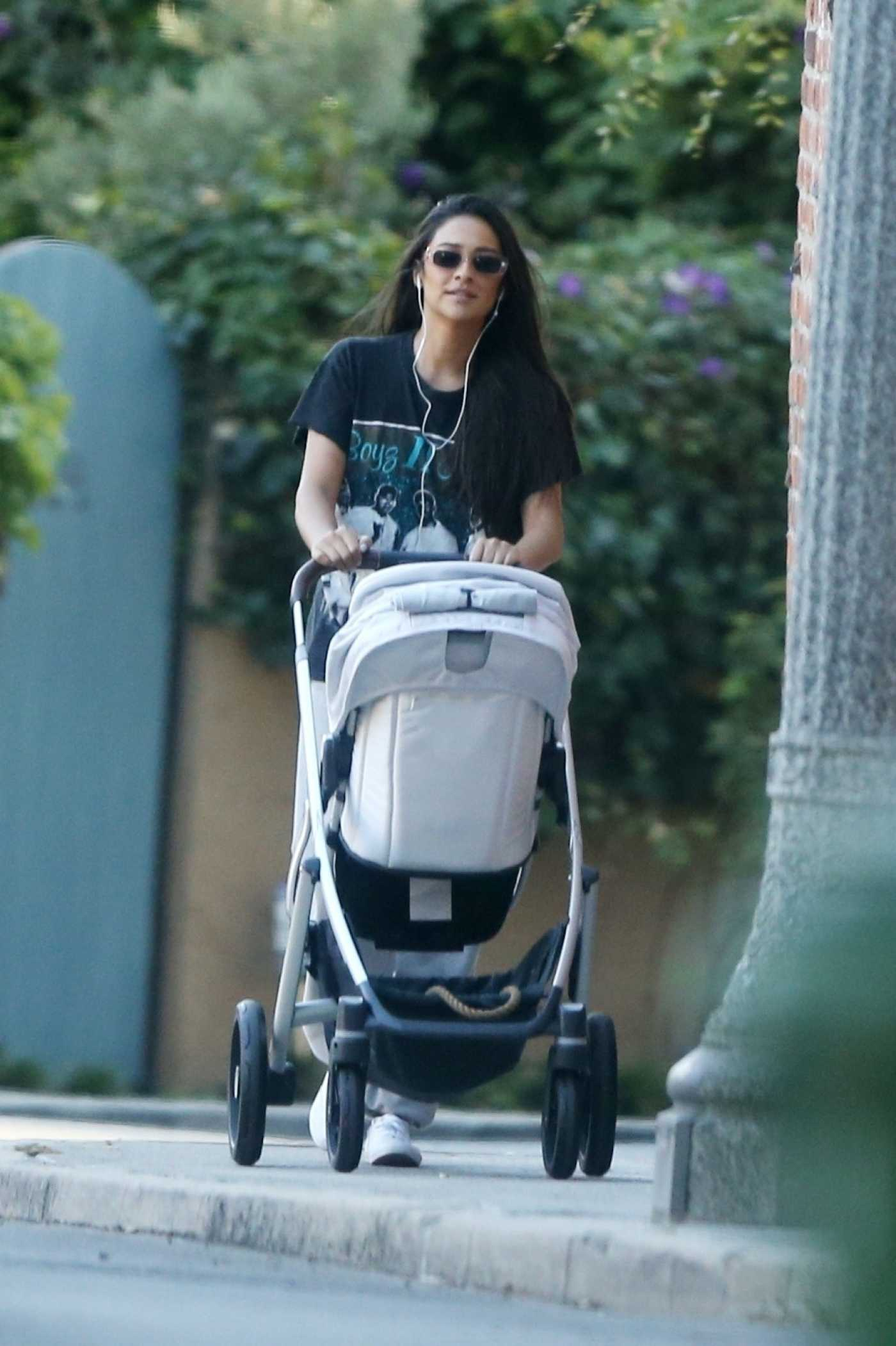 Shay Mitchell in a Black Tee Walks Out with Her Baby in Los Angeles 06/25/2020
