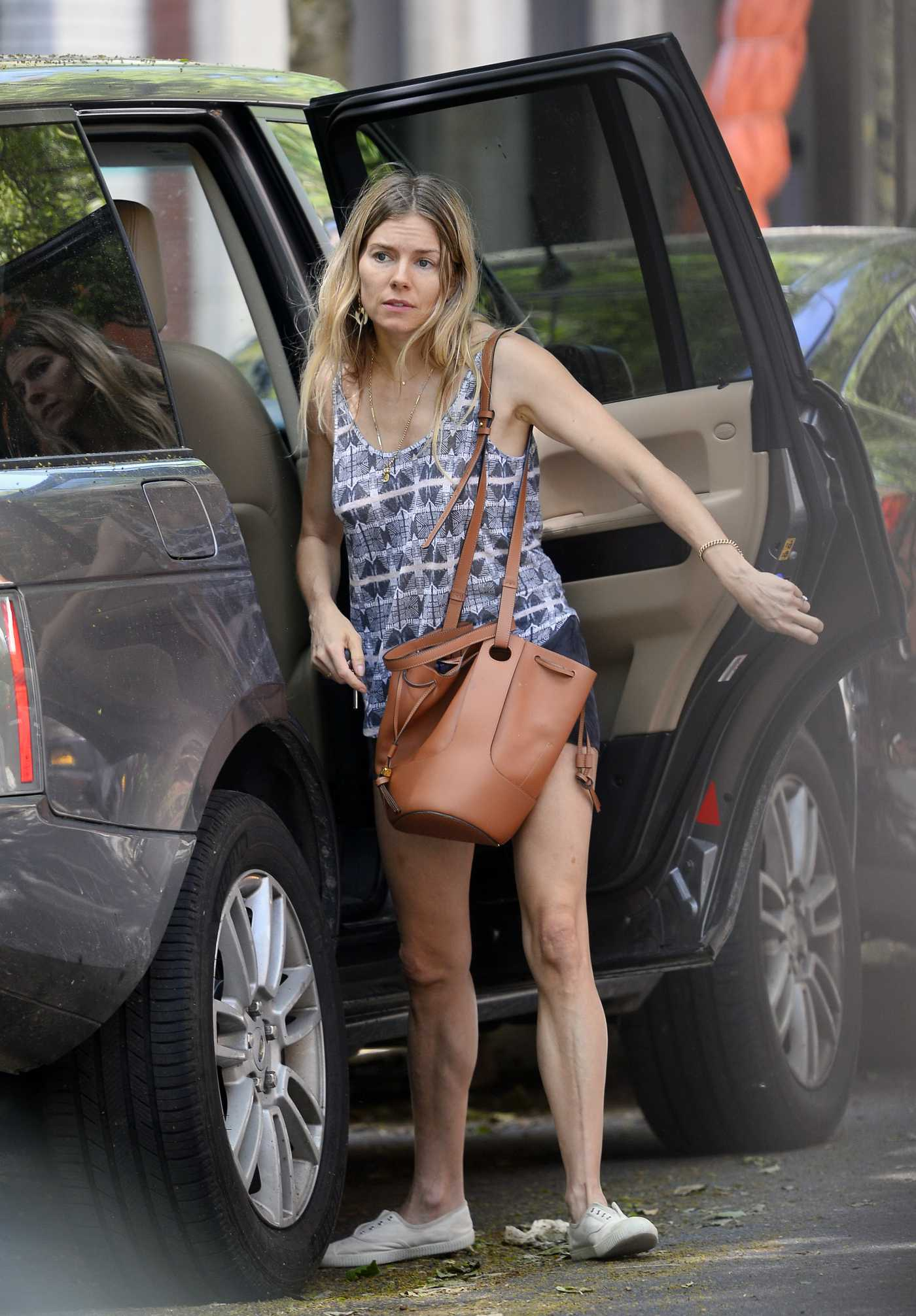 Sienna Miller in a Black Shorts Was Seen Out with Tom Sturridge in New York 05/31/2020