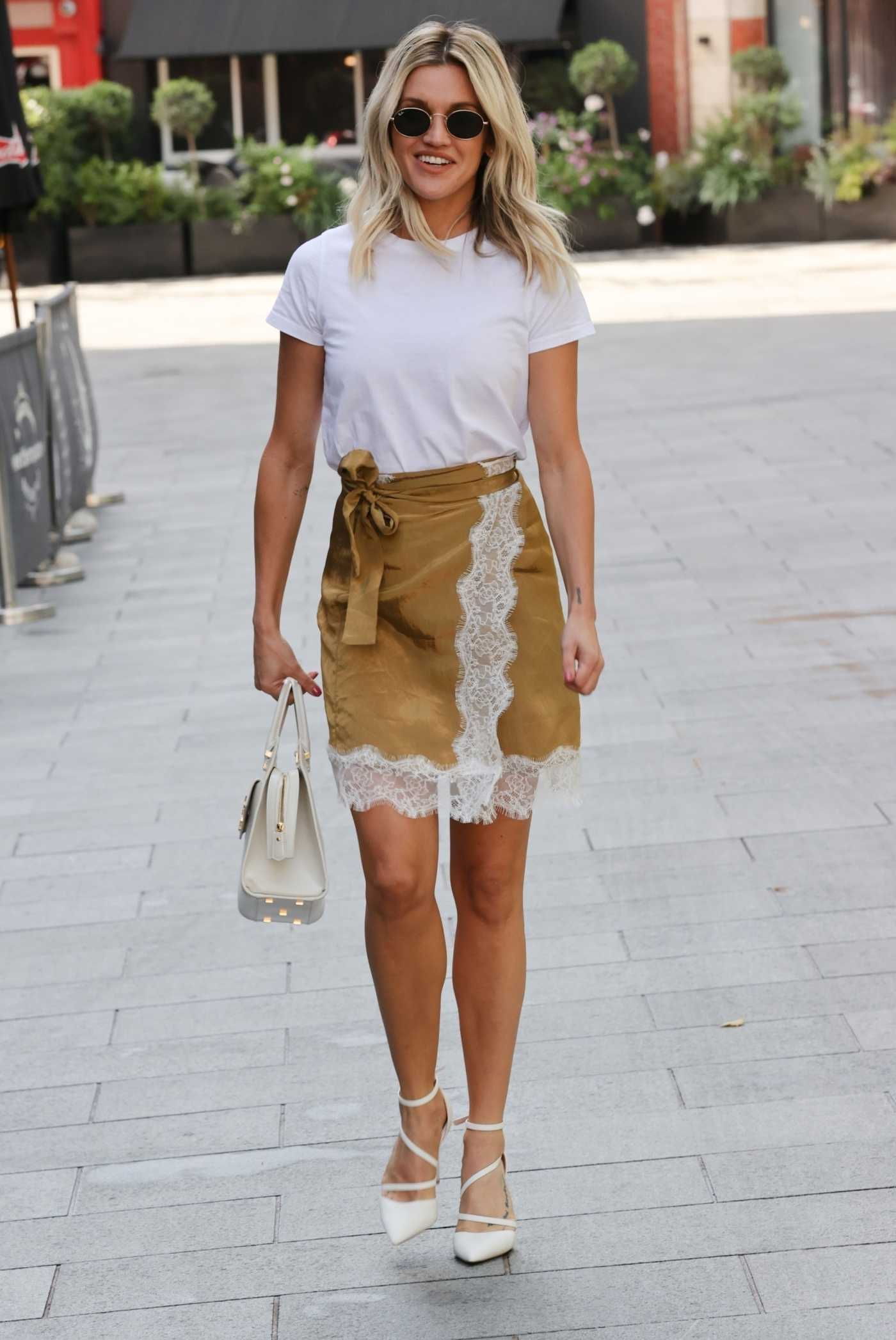 Ashley Roberts in a Gold Skirt Exits the Heart Radio Studios in London 07/22/2020