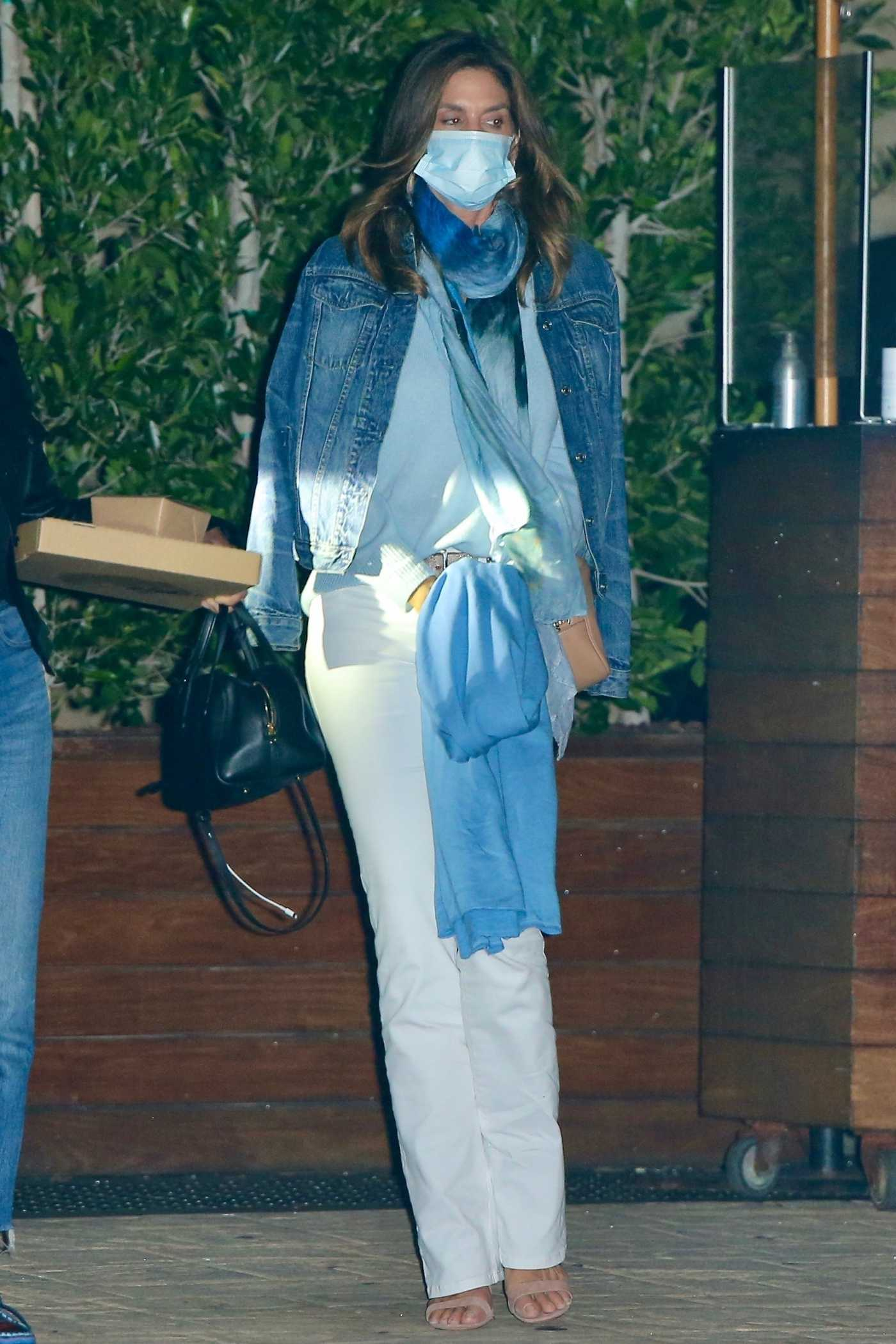 Cindy Crawford in a Protective Mask Leaves Dinner at SoHo House in New York 07/29/2020