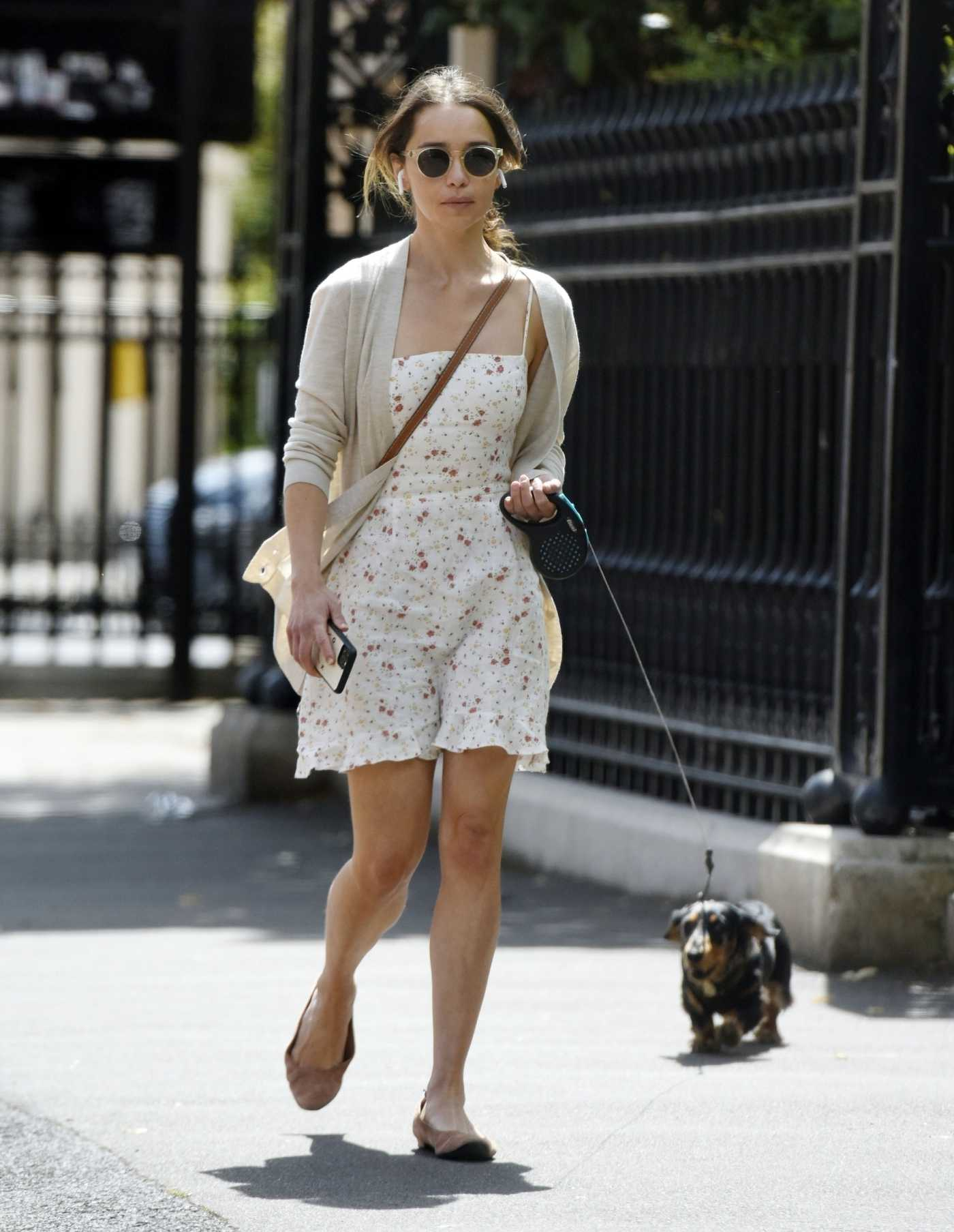 Emilia Clarke in a White Floral Dress Walks Her Dog in London 07/13/2020