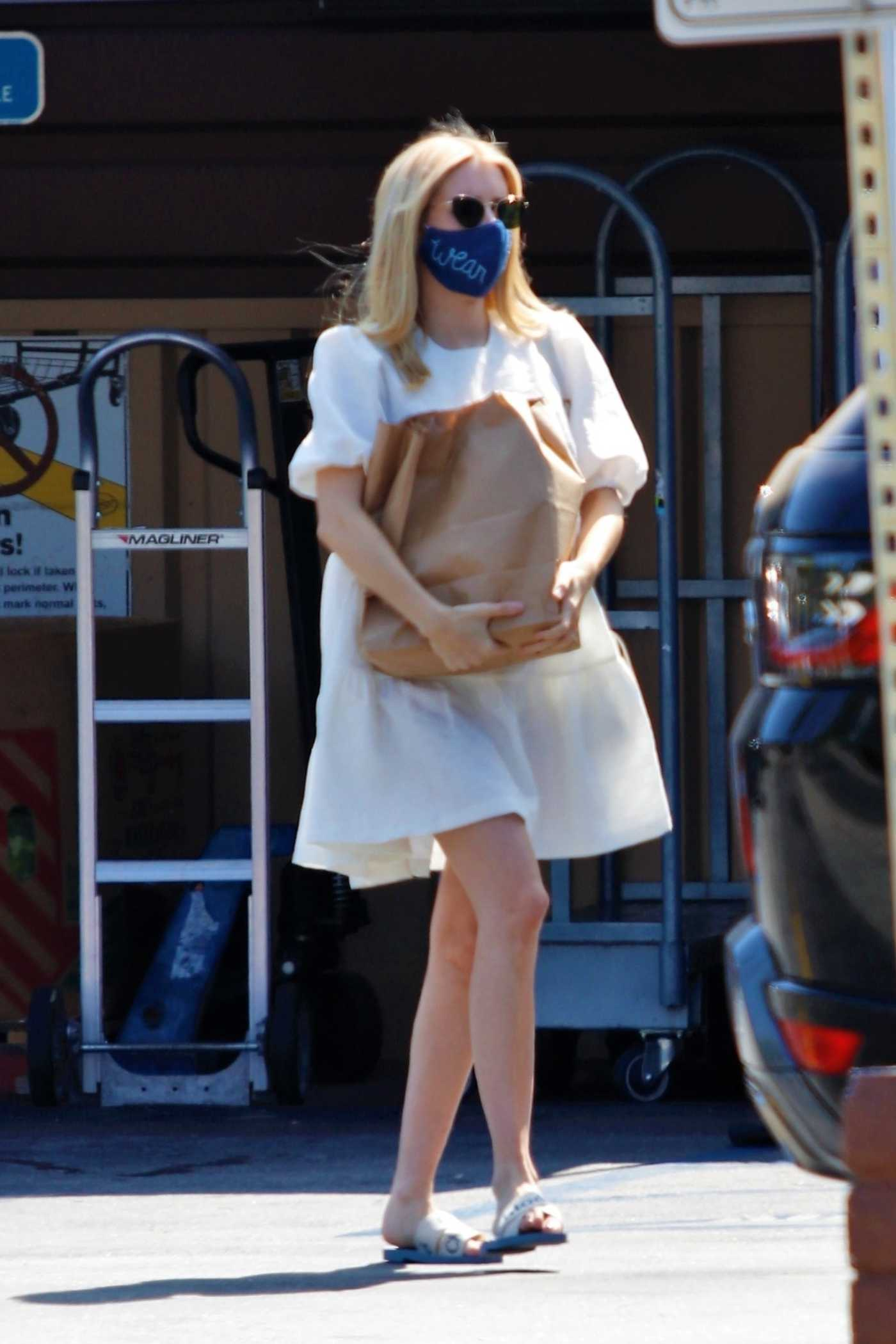 Emma Roberts in a White Dress Leaves a Grocery Market in Los Angeles 07/25/2020