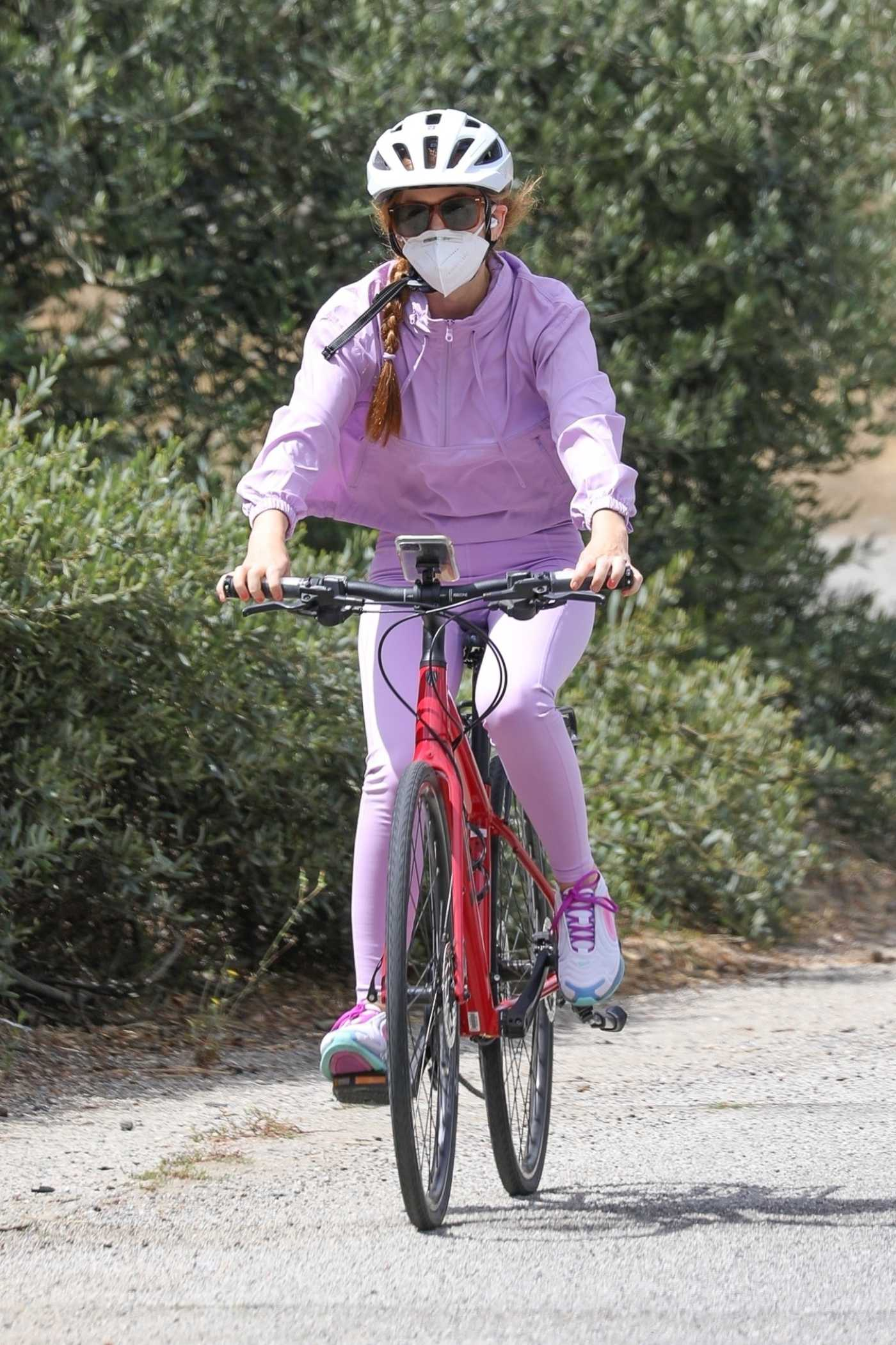 Isla Fisher in a Purple Tracksuit Does Her Daily Bike Ride in Los Angeles 06/29/2020