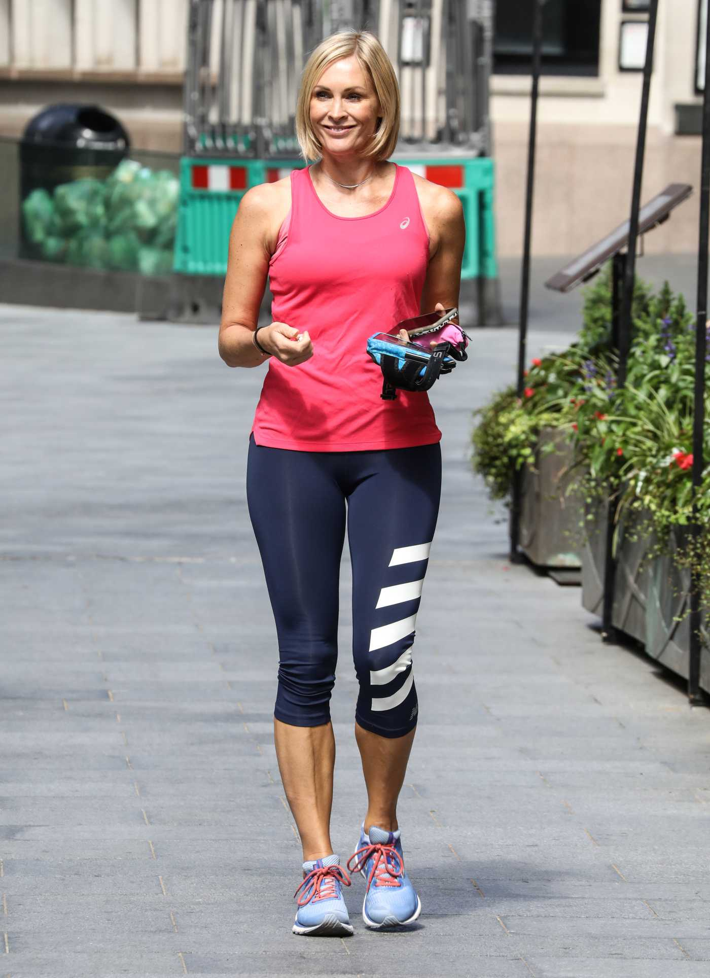 Jenni Falconer in a Red Tank Top Leaves the Global Radio Studios in London 07/13/2020