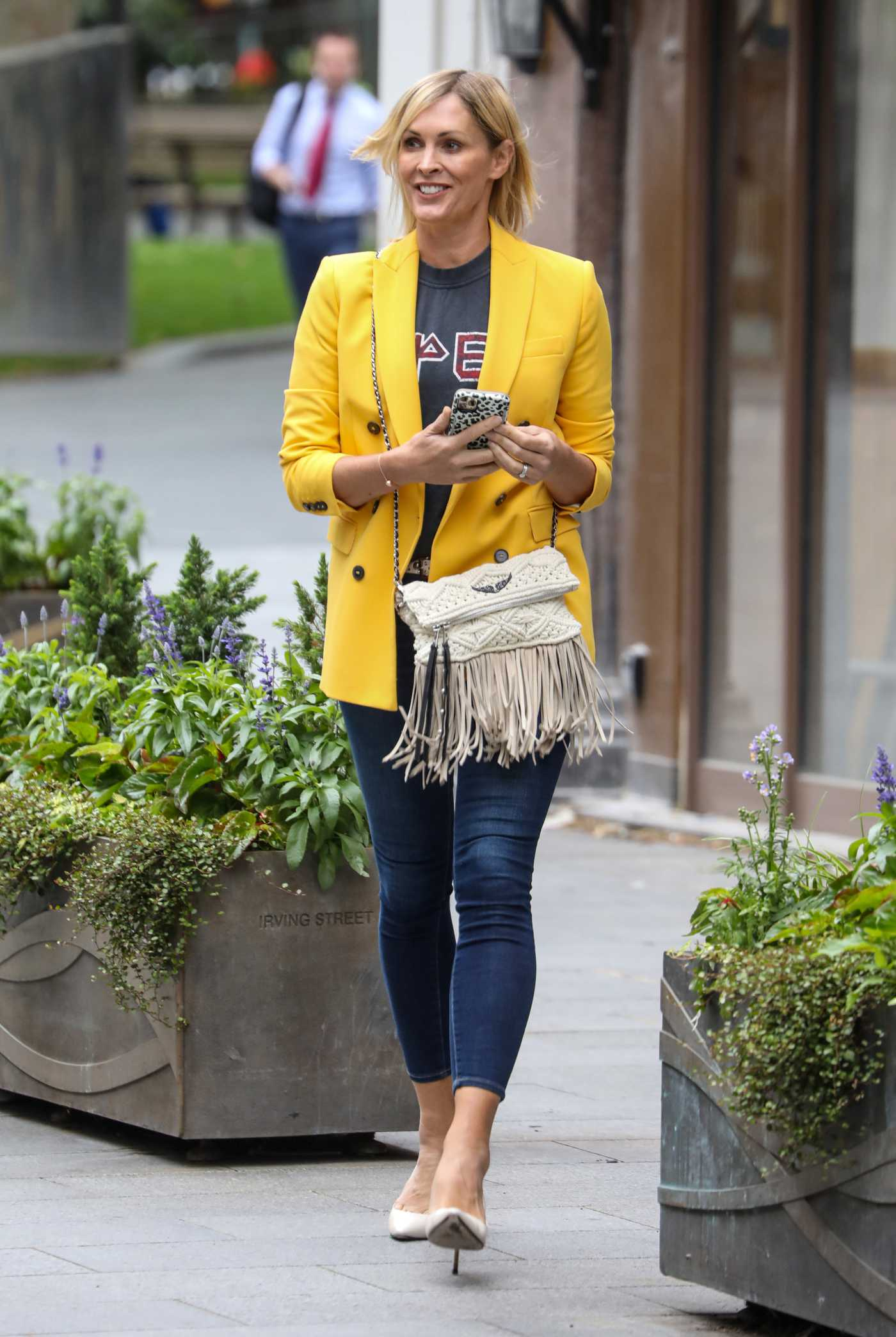 Jenni Falconer in a Yellow Blazer Leaves the Global Radio Studios in London 06/29/2020
