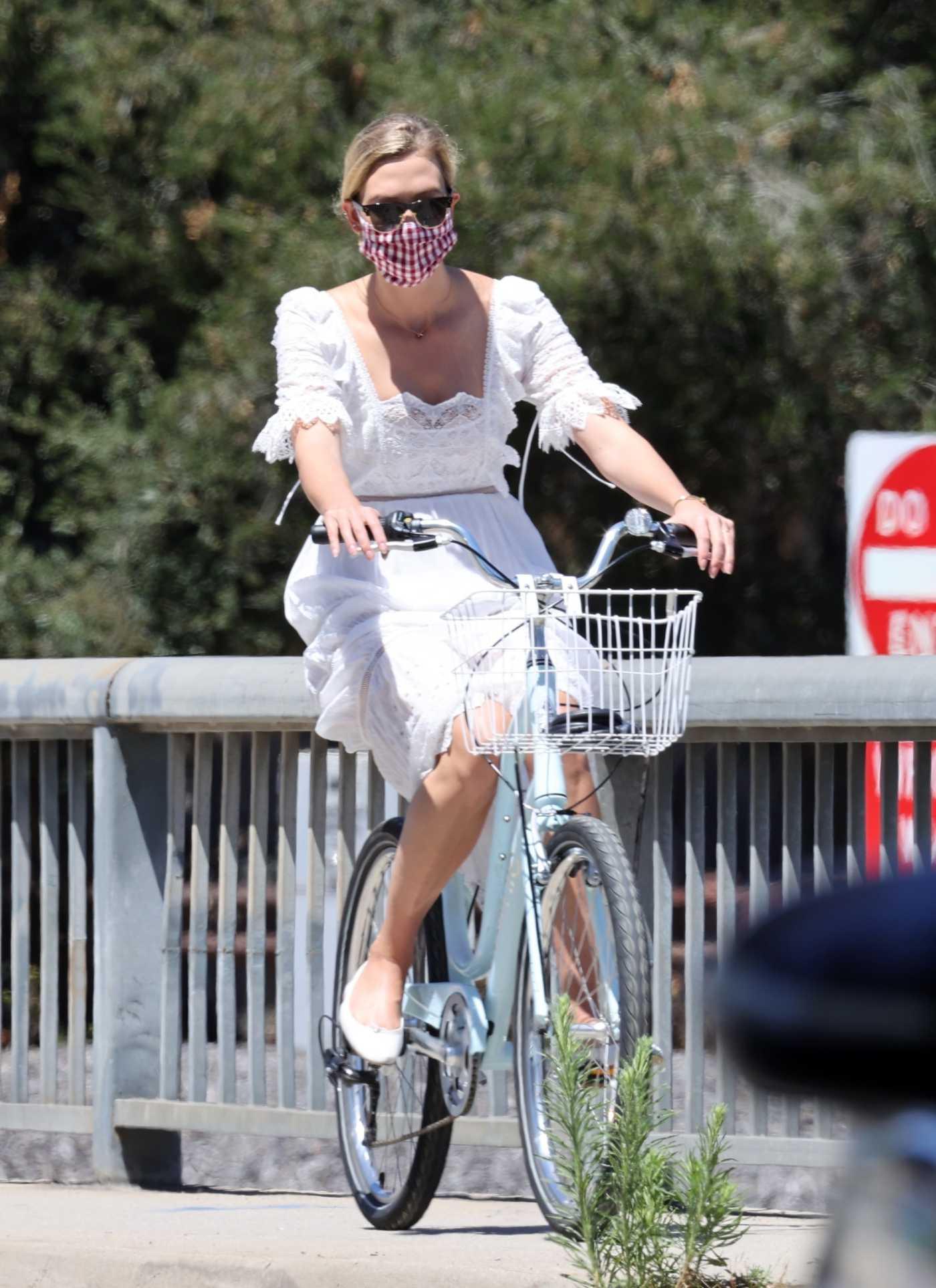 Karlie Kloss in a White Dress Does a Bike Ride in Santa Monica 07/18/2020