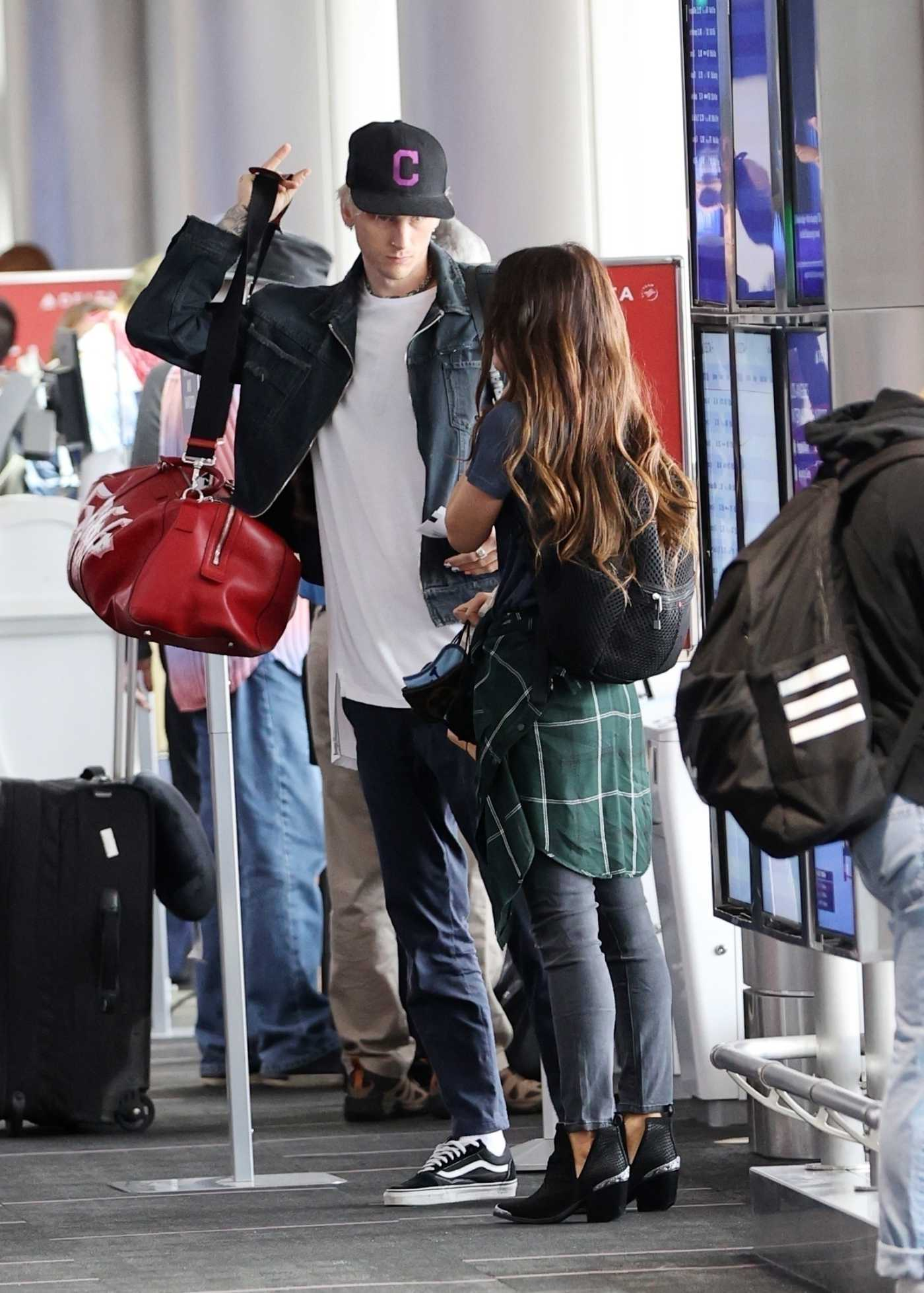 Machine Gun Kelly in a Black Cap Arrives at LAX Airport Out with Megan Fox in Los Angeles 06/29/2020