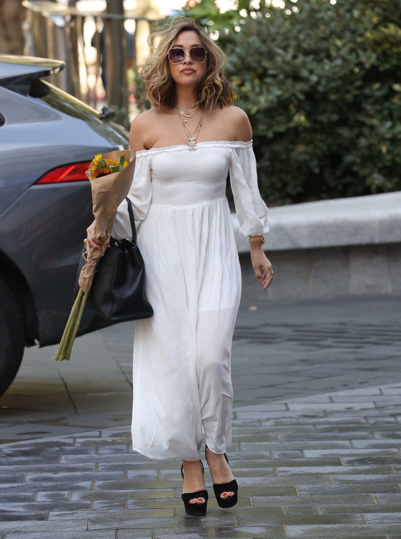 Myleene Klass in a White Dress Arrives at the Smooth Radio Studios in London 07/22/2020