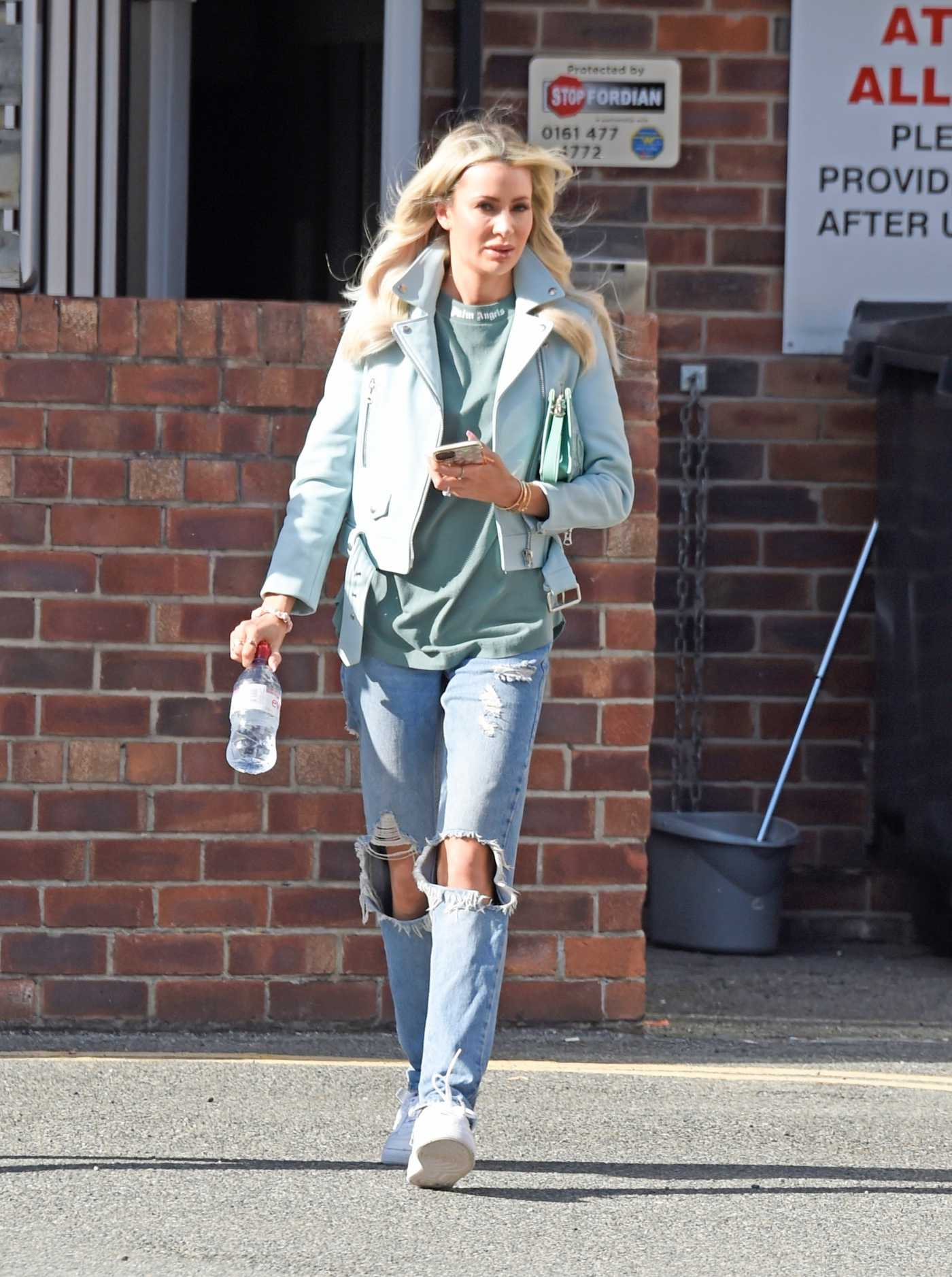 Olivia Attwood in a Blue Ripped Jeans Leaves Beauty Cutie Hair Salon in Cheshire 07/10/2020