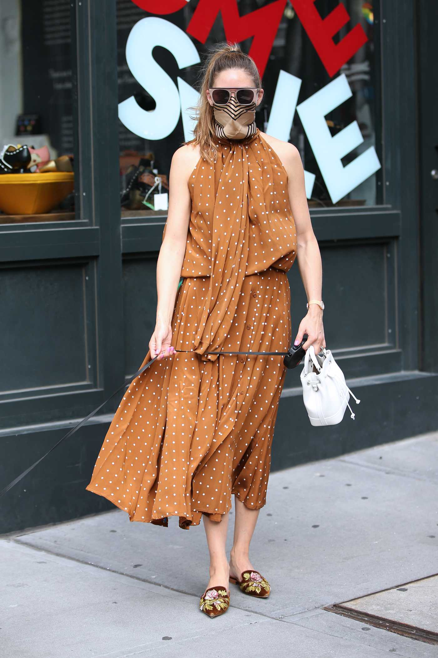 Olivia Palermo in a Tan Polka Dot Dress Walks Her Dog in New York 07/23/2020