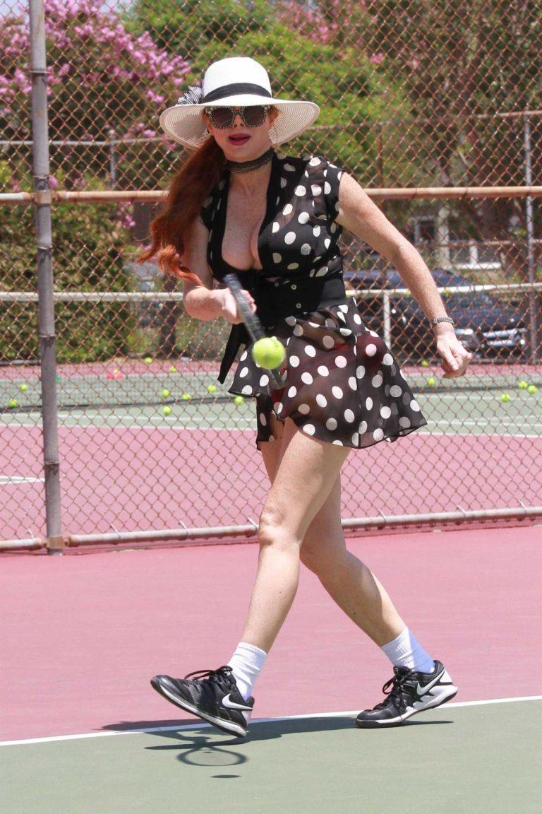 Phoebe Price in a Black Polka Dot Dress