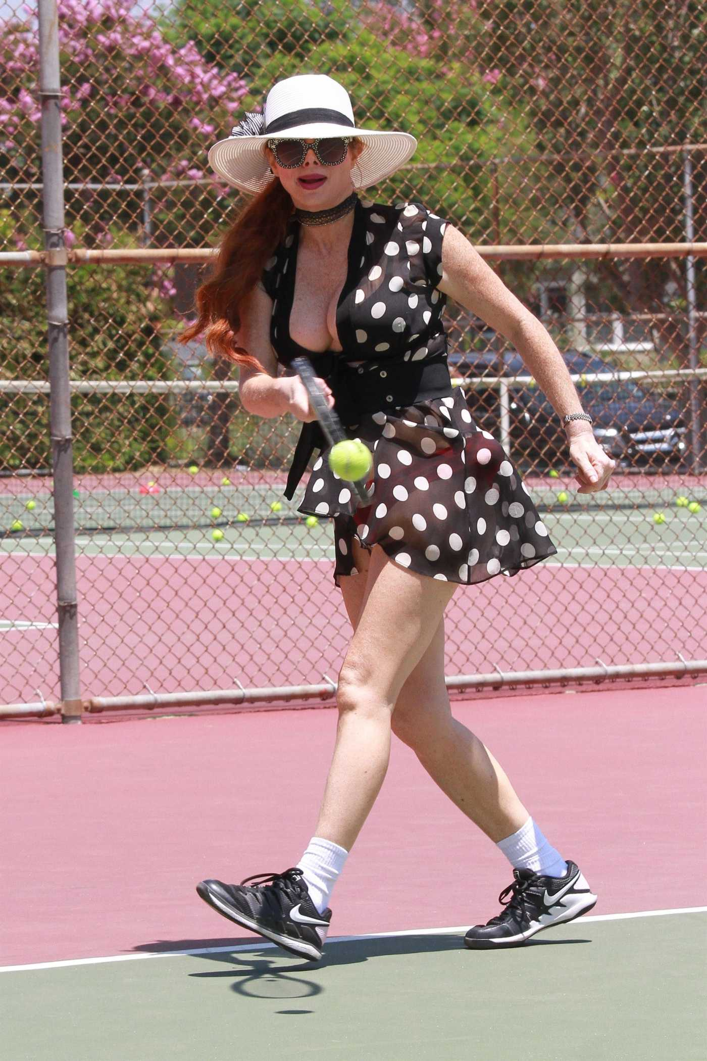 Phoebe Price in a Black Polka Dot Dress Shows off Her Moves on the Tennis Court in Los Angeles 07/23/2020